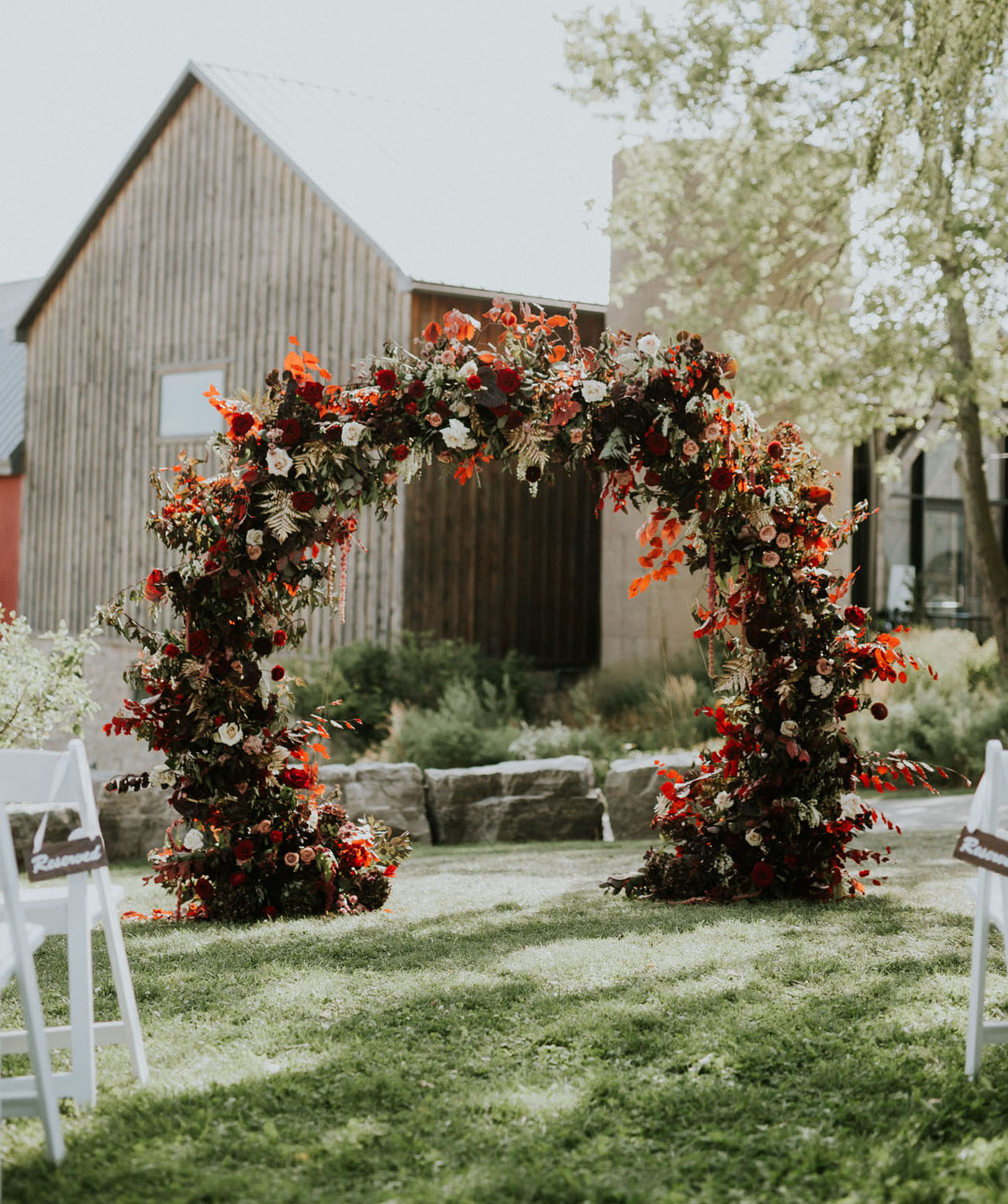 red floral ceremony arch