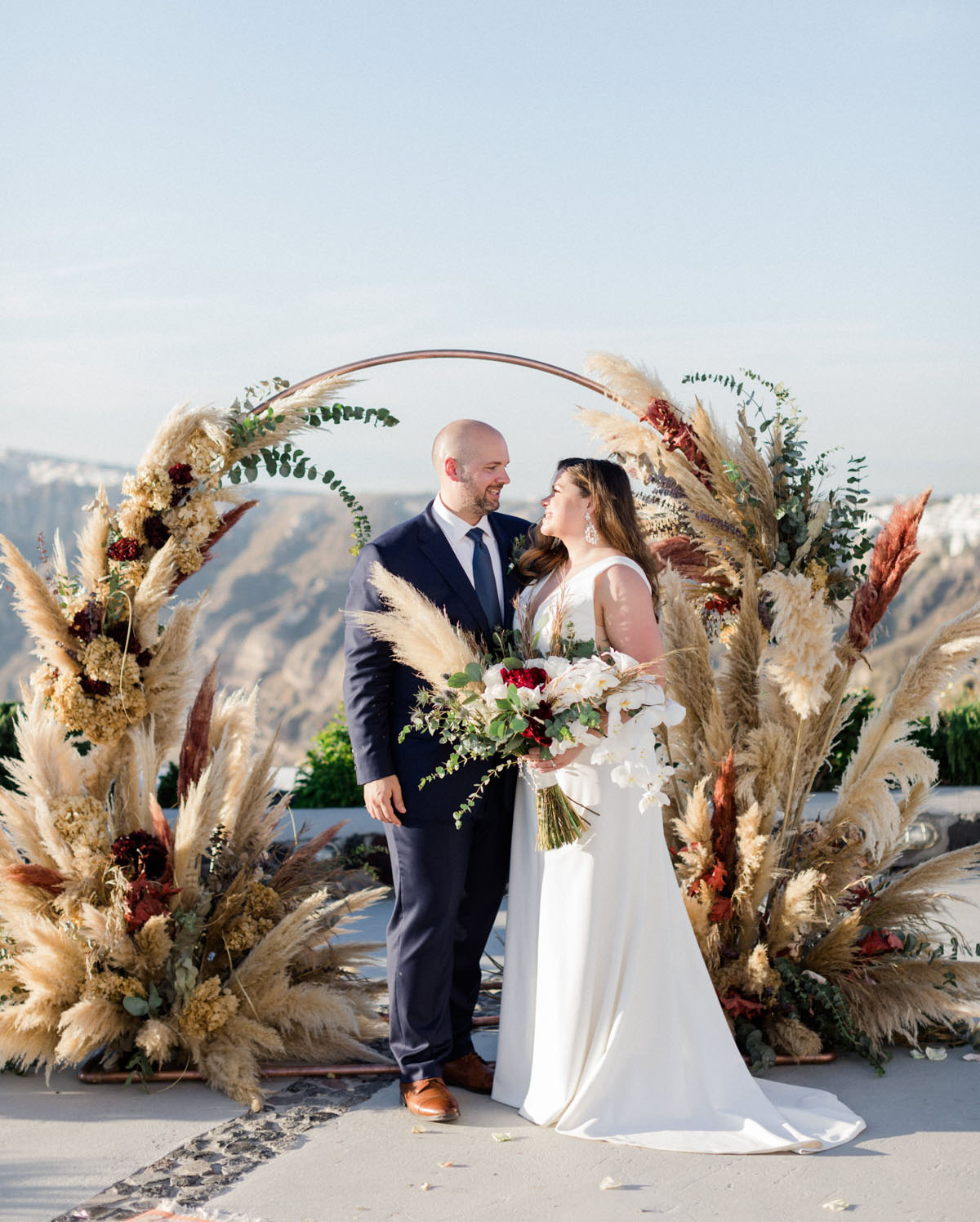 Cliffside Winery Wedding in Santorini with Romantic Pampas Grass Decor