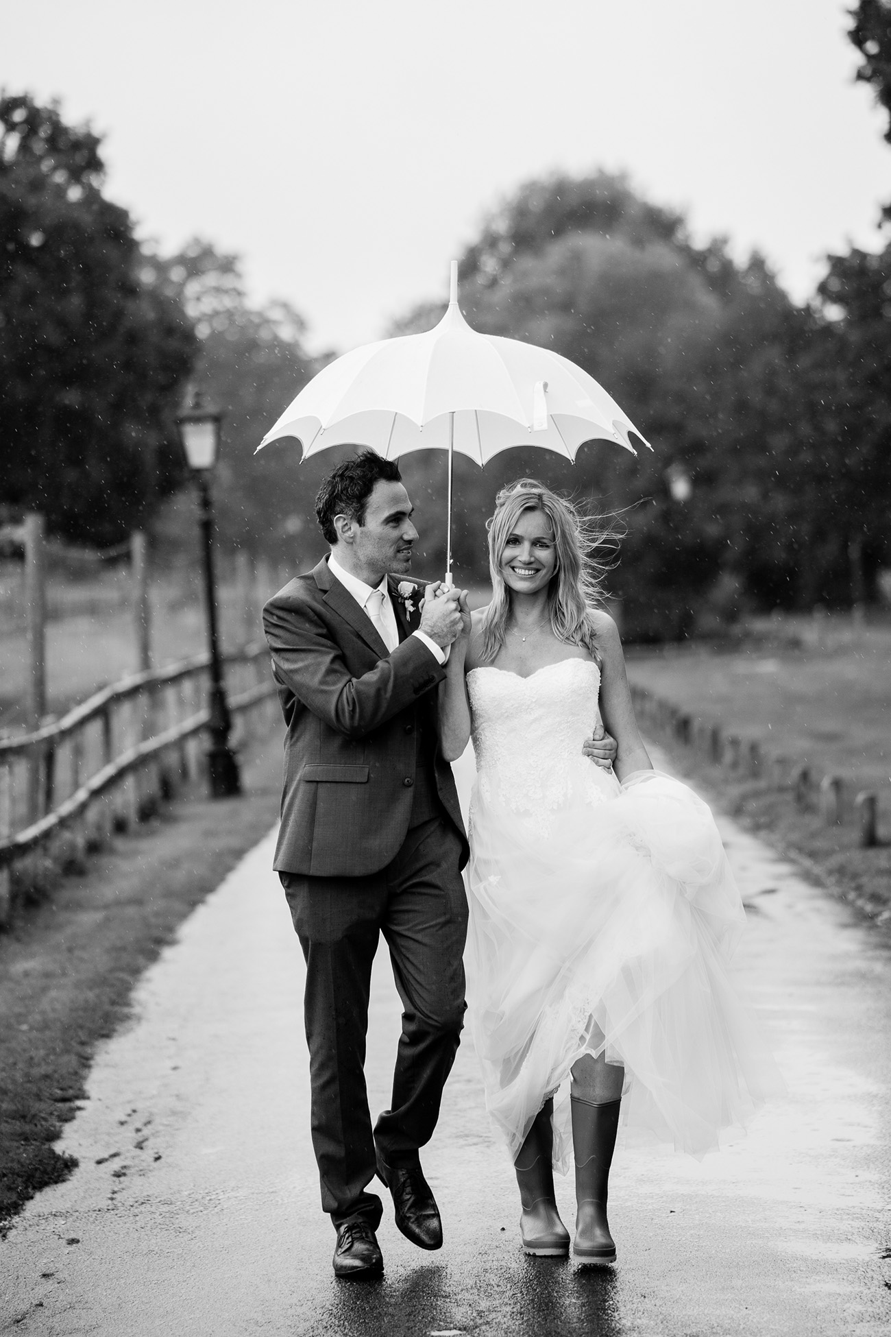 cute couple with umbrella rainy wedding