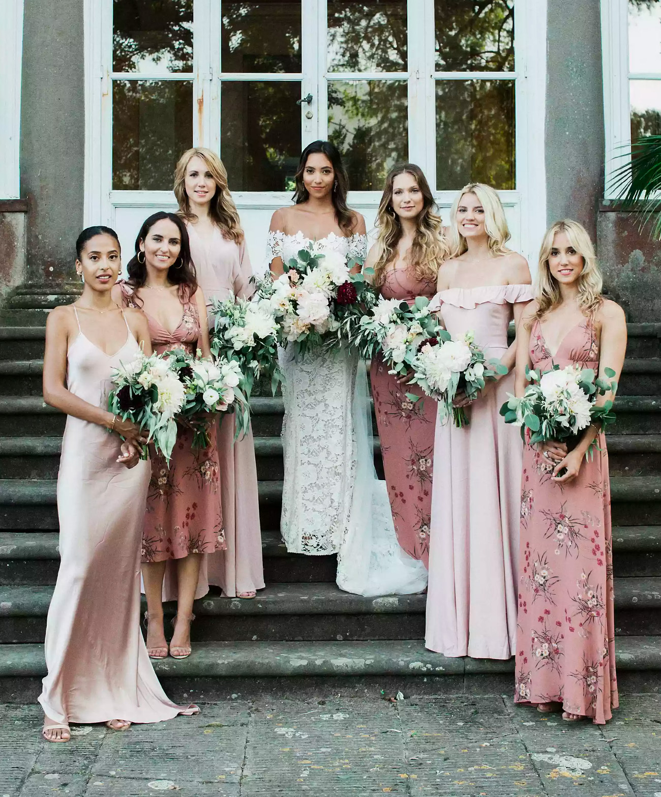 Bride in Carter Wedding Dress with bridesmaids in blush florals