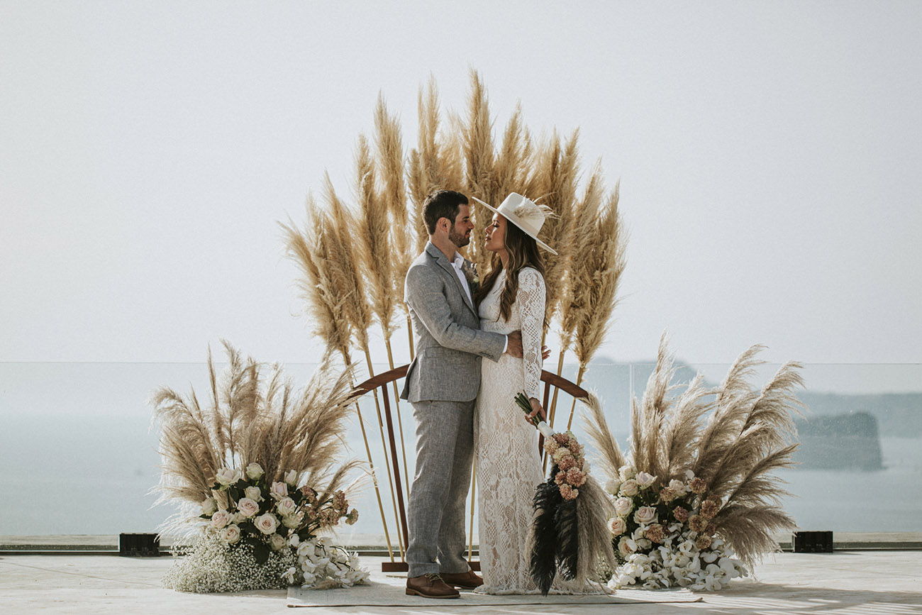 Santorini elopement with pampas grass backdrop