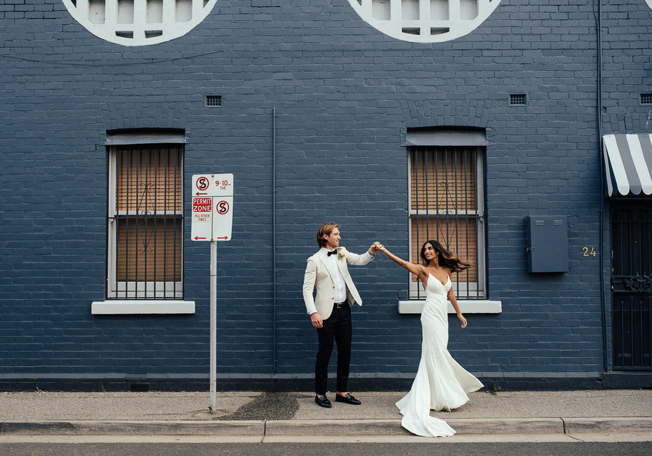Dancing in the Streets in the Wyatt Gown by Lovers Society and Green Wedding Shoes
