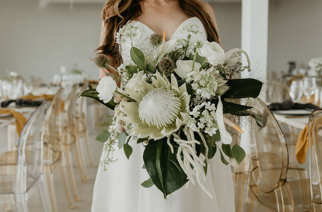 white and green protea bouquet