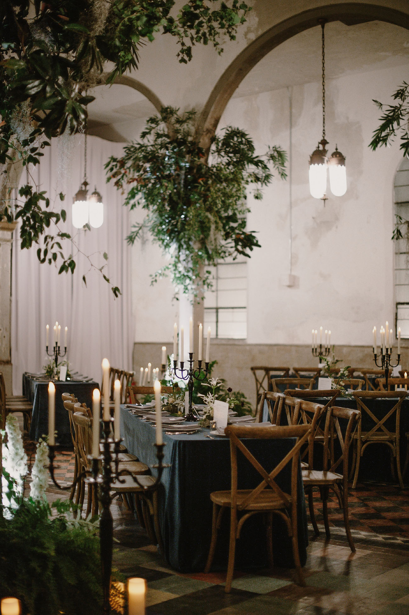 moody masculine wedding decor with hanging greenery