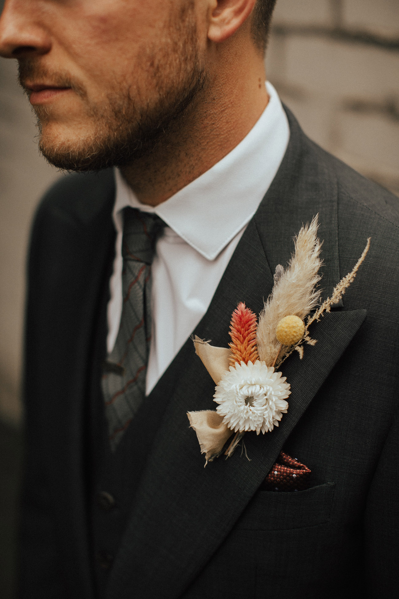 masculine boutonniere of dried flowers