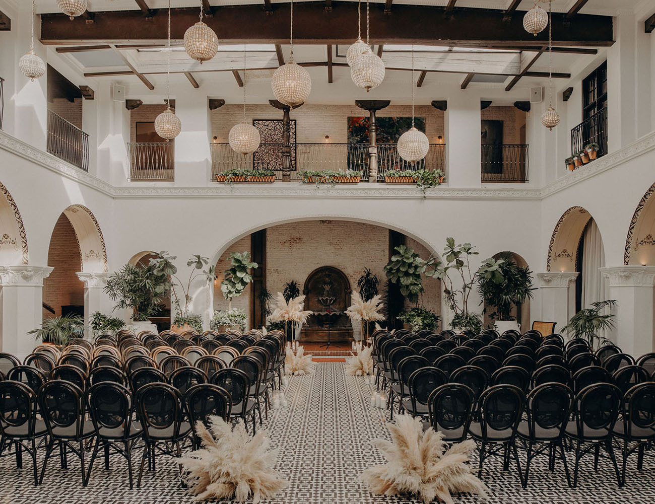 Masculine wedding ceremony decor with pampas grass