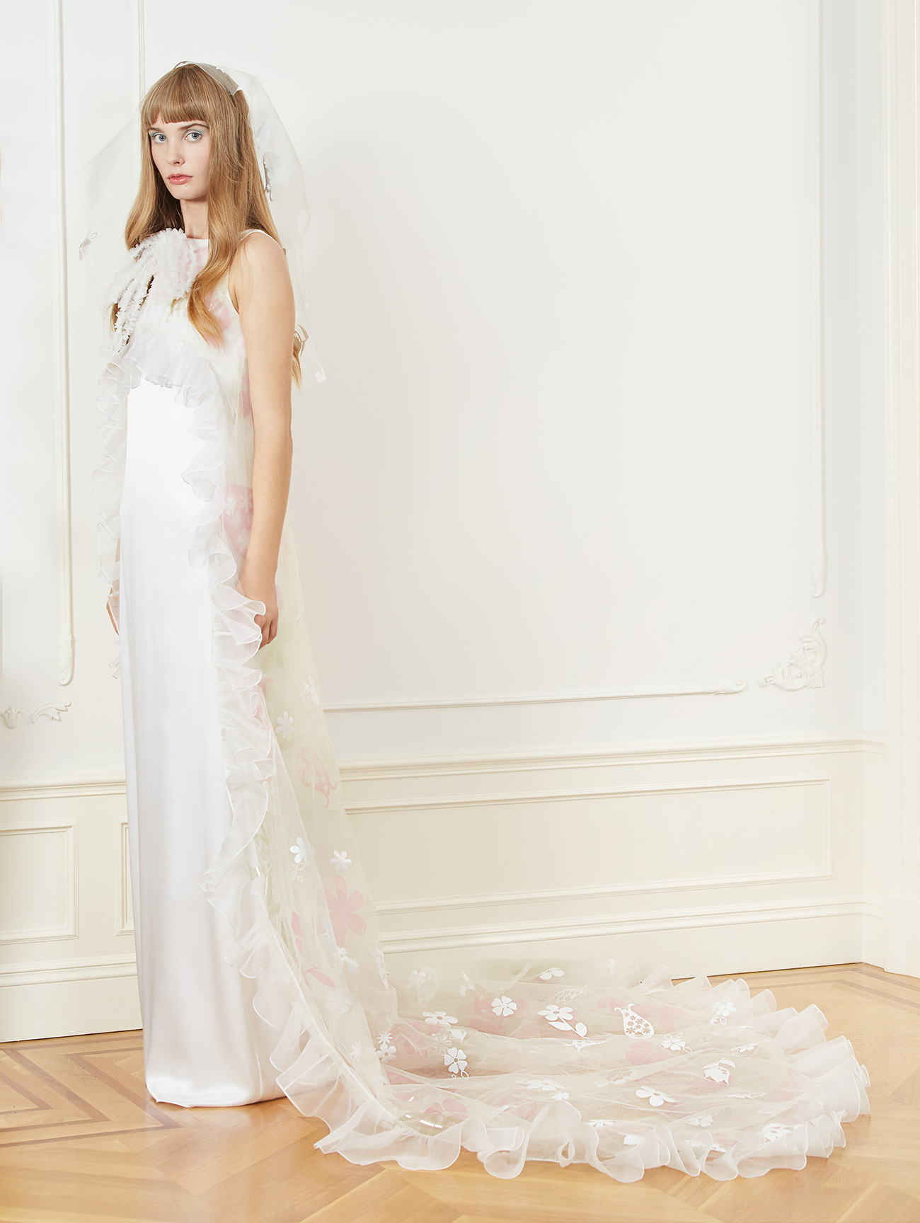 laser cut floral cape gown by Hunter