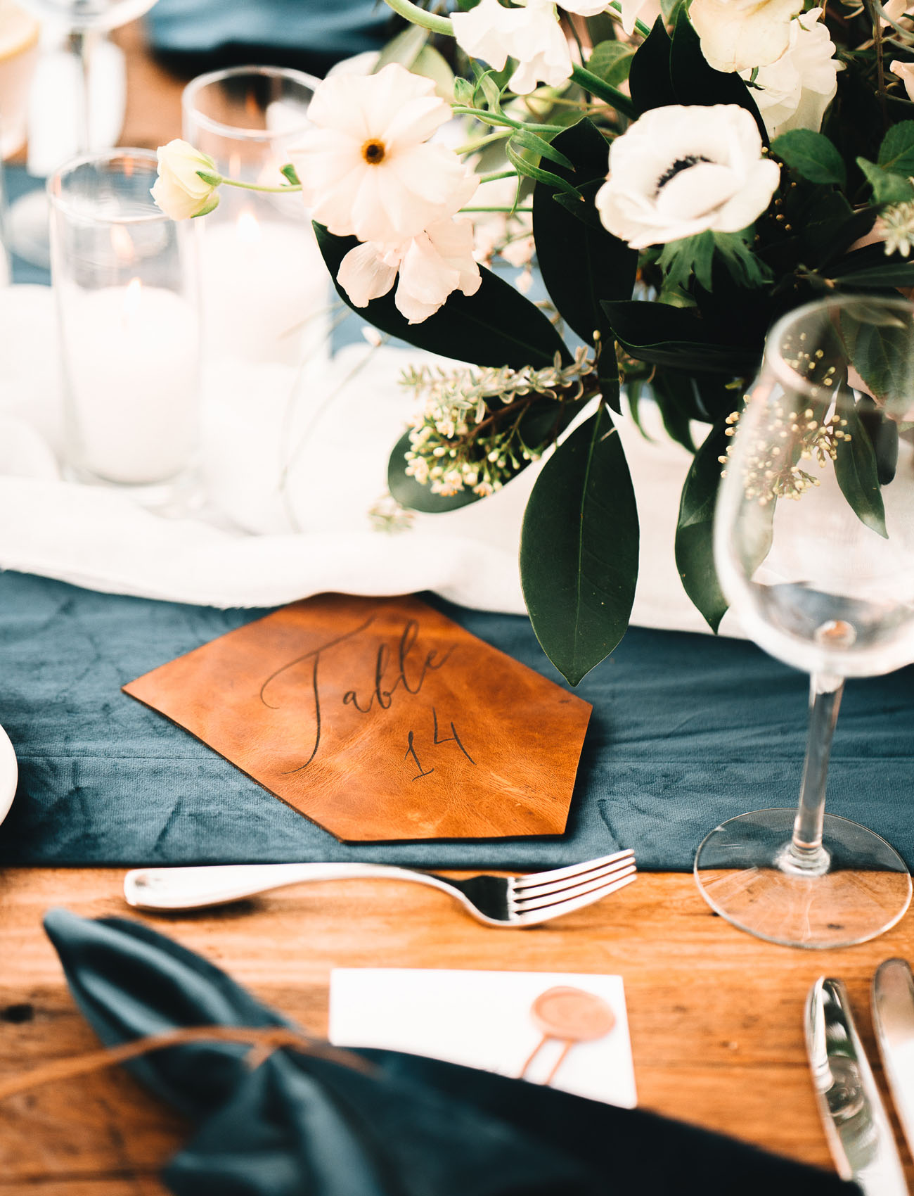 masculine wedding details- leather table numbers