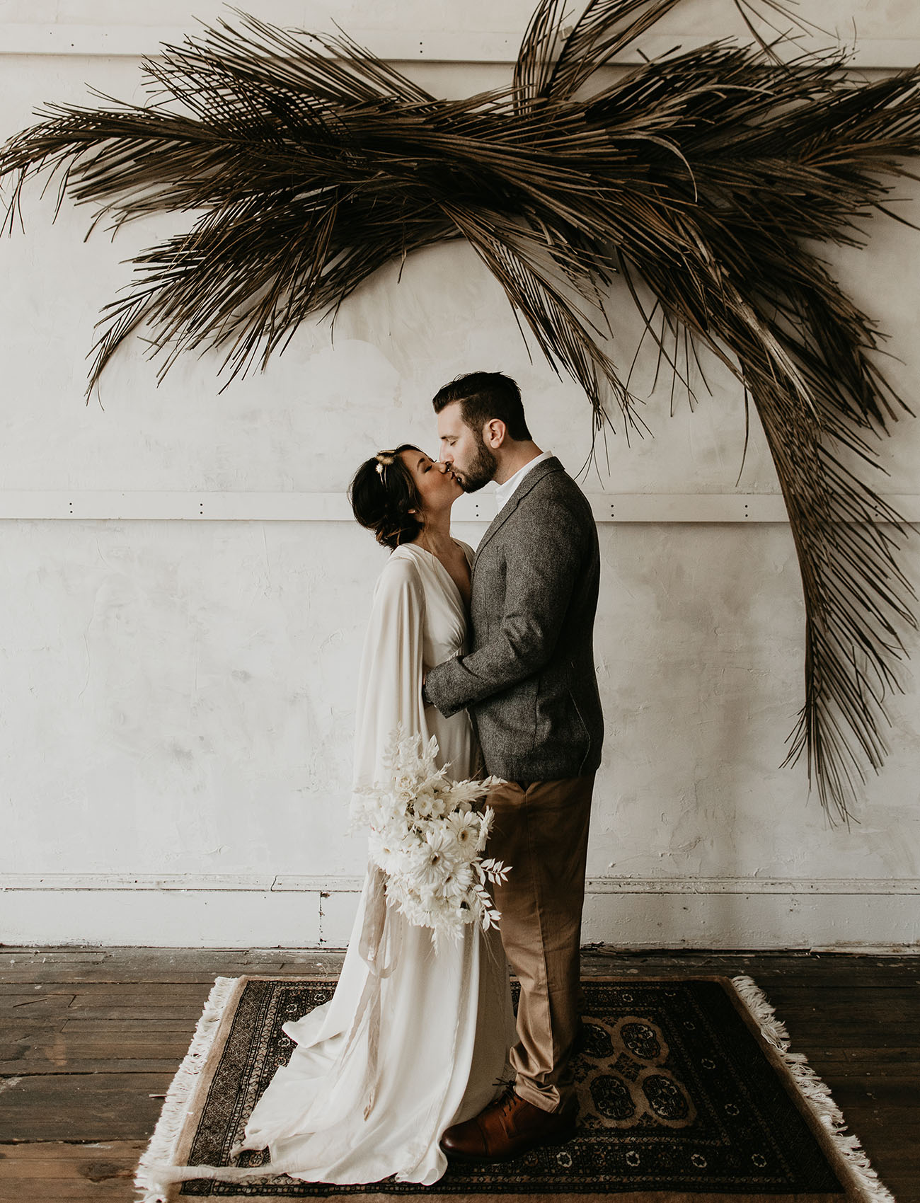 dried palm hanging installation- masculine wedding decor