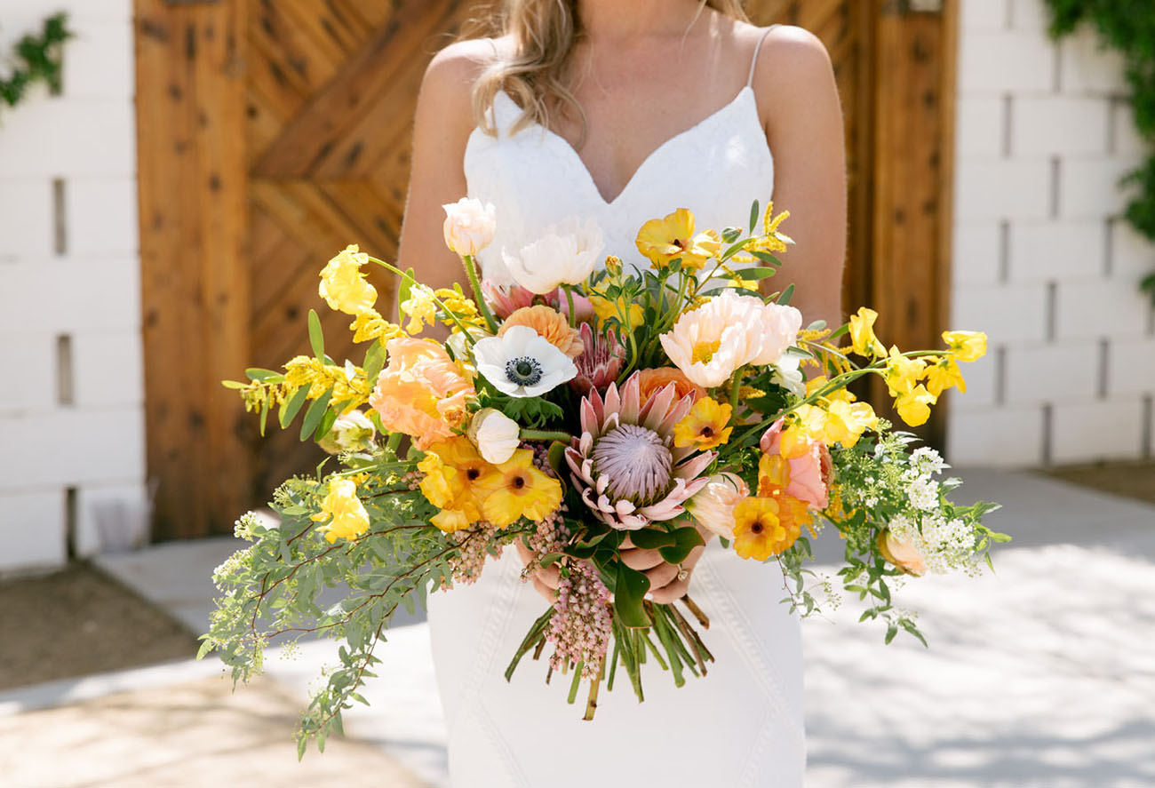 yellow flower and protea bouquet