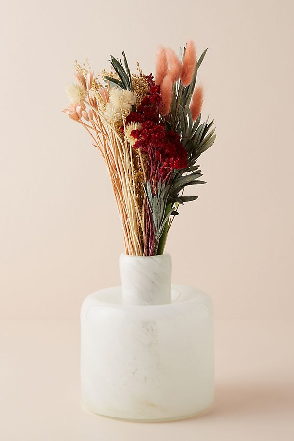 dried pink bouquet of flowers in white vase