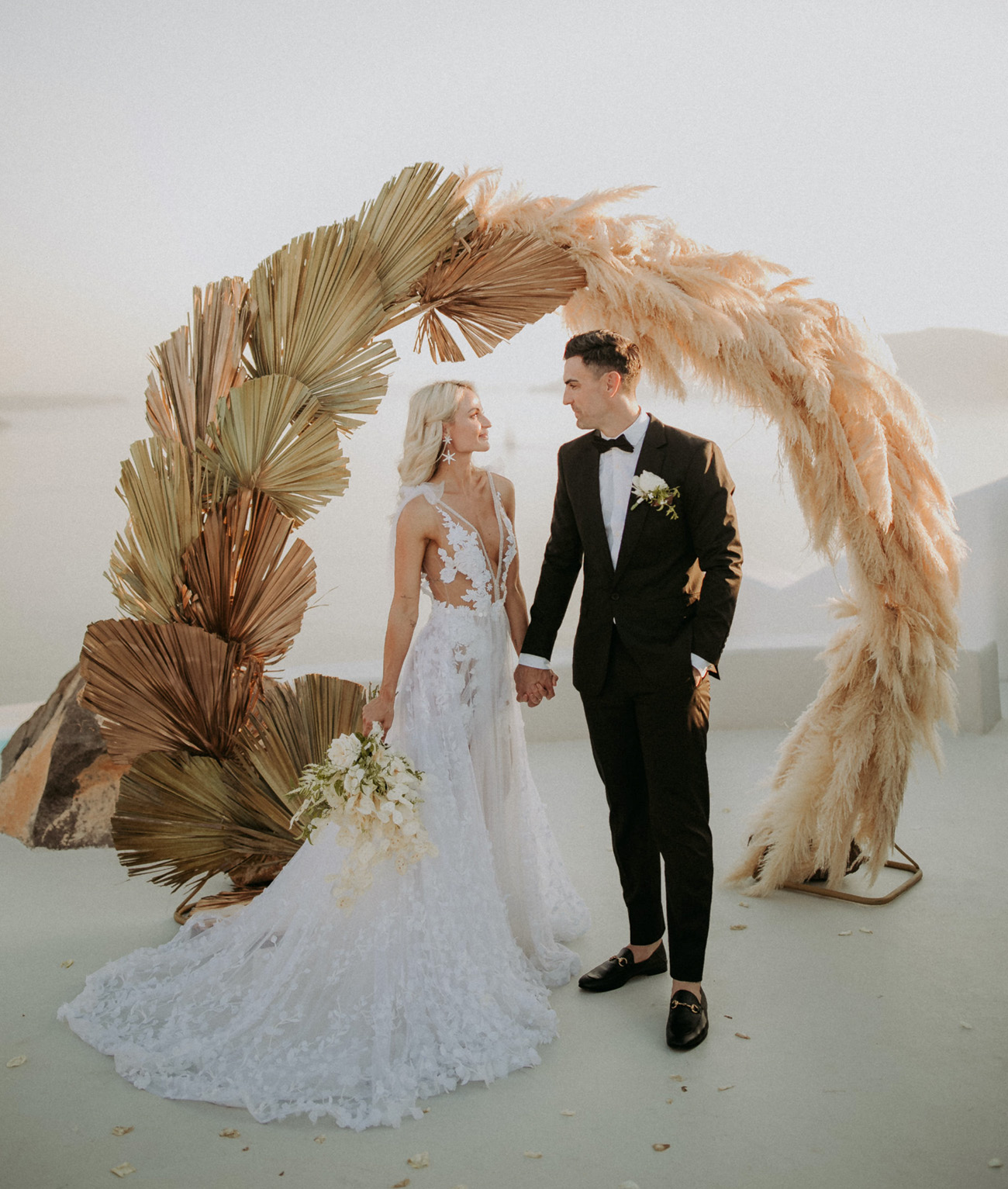 pampas grass and dried palm ceremony backdrop