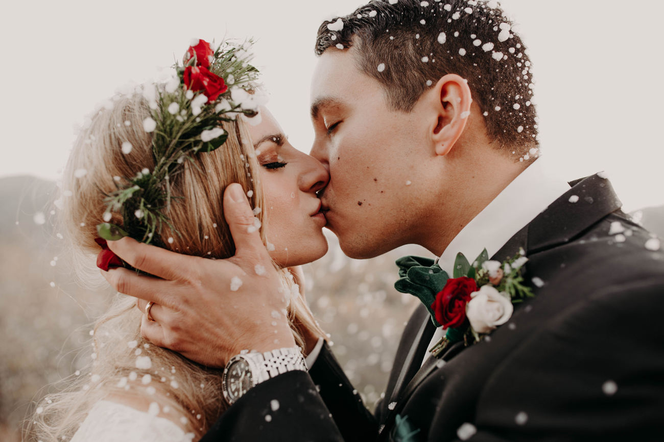 Bride and Groom Kiss in the Snow