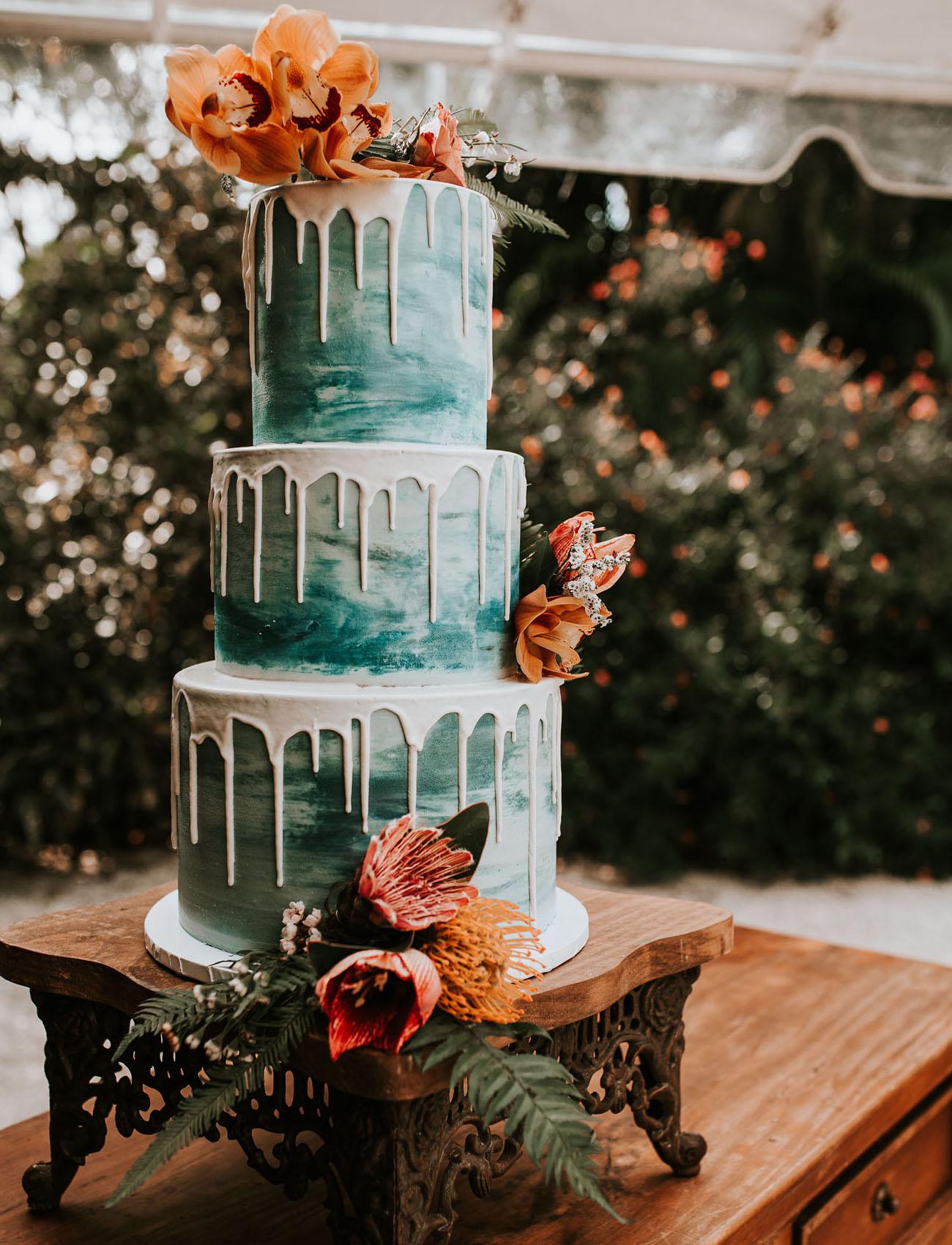 teal drip wedding cake