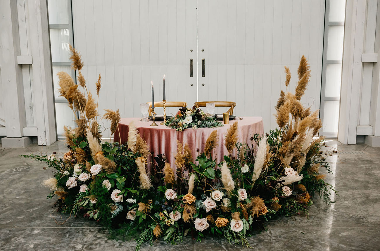floral filled sweetheart table