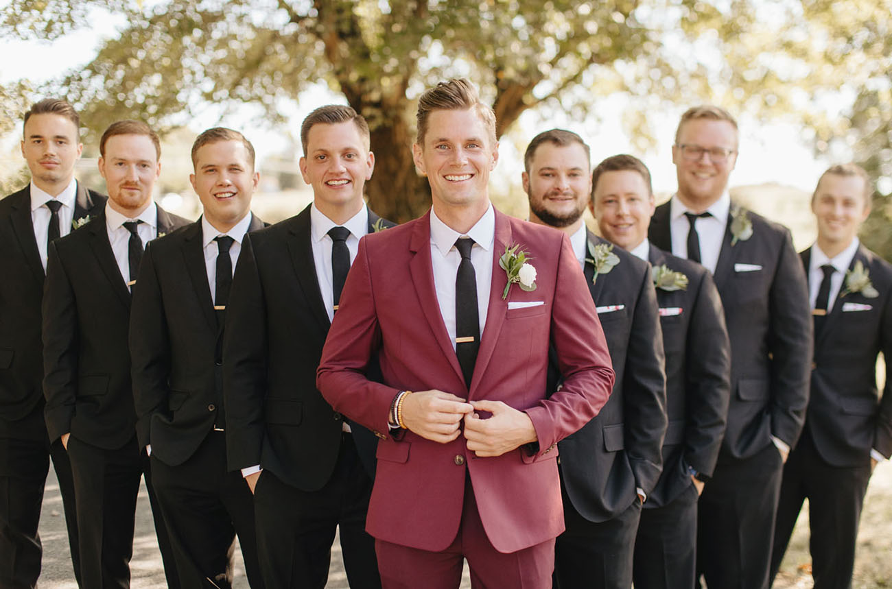 red suit groom