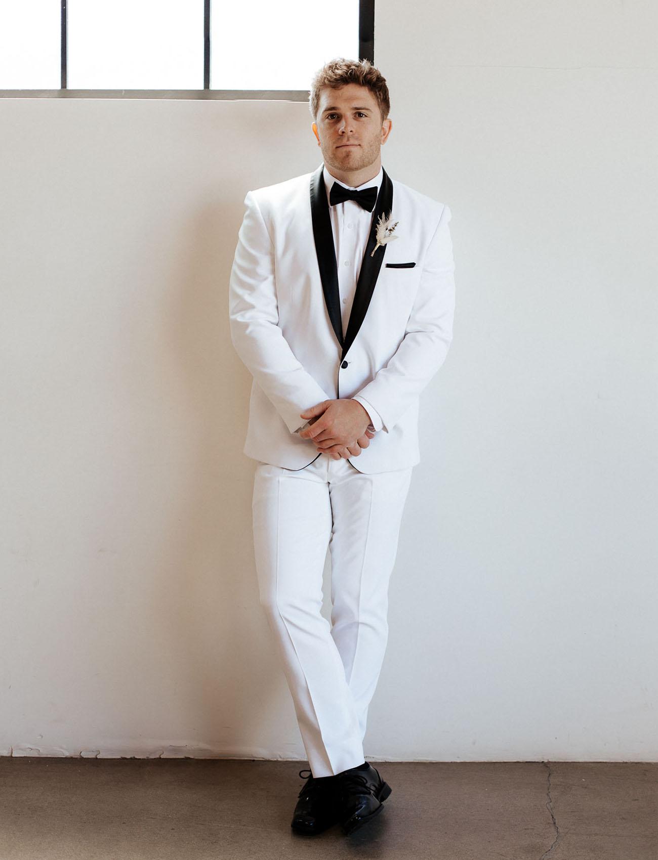 white tux groom