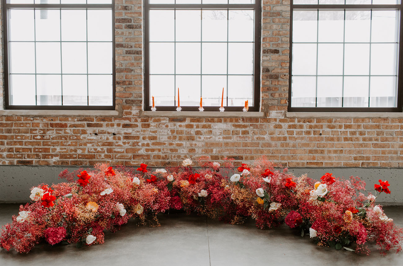red floral wedding ceremony