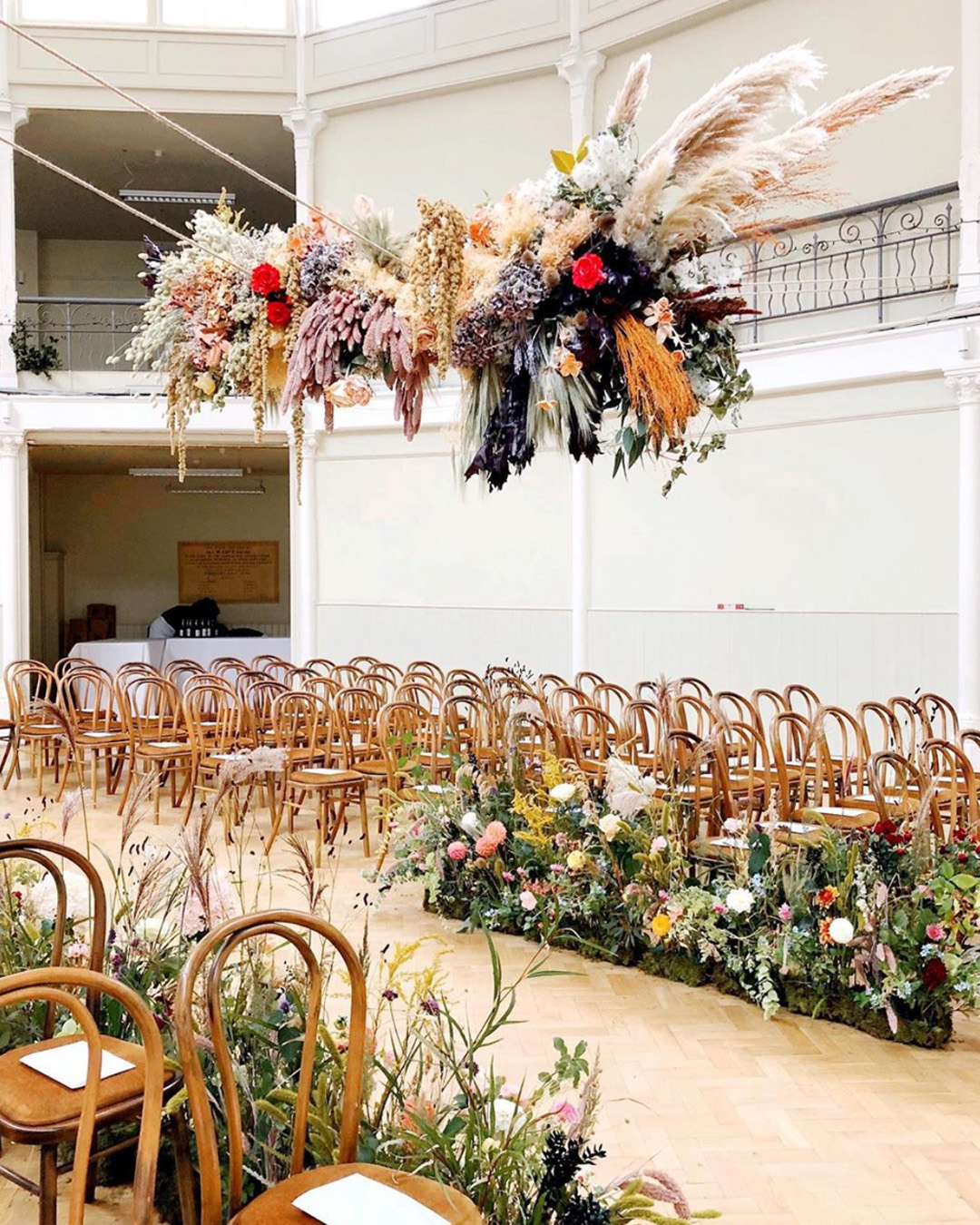 giant hanging flower installation for ceremony aisle