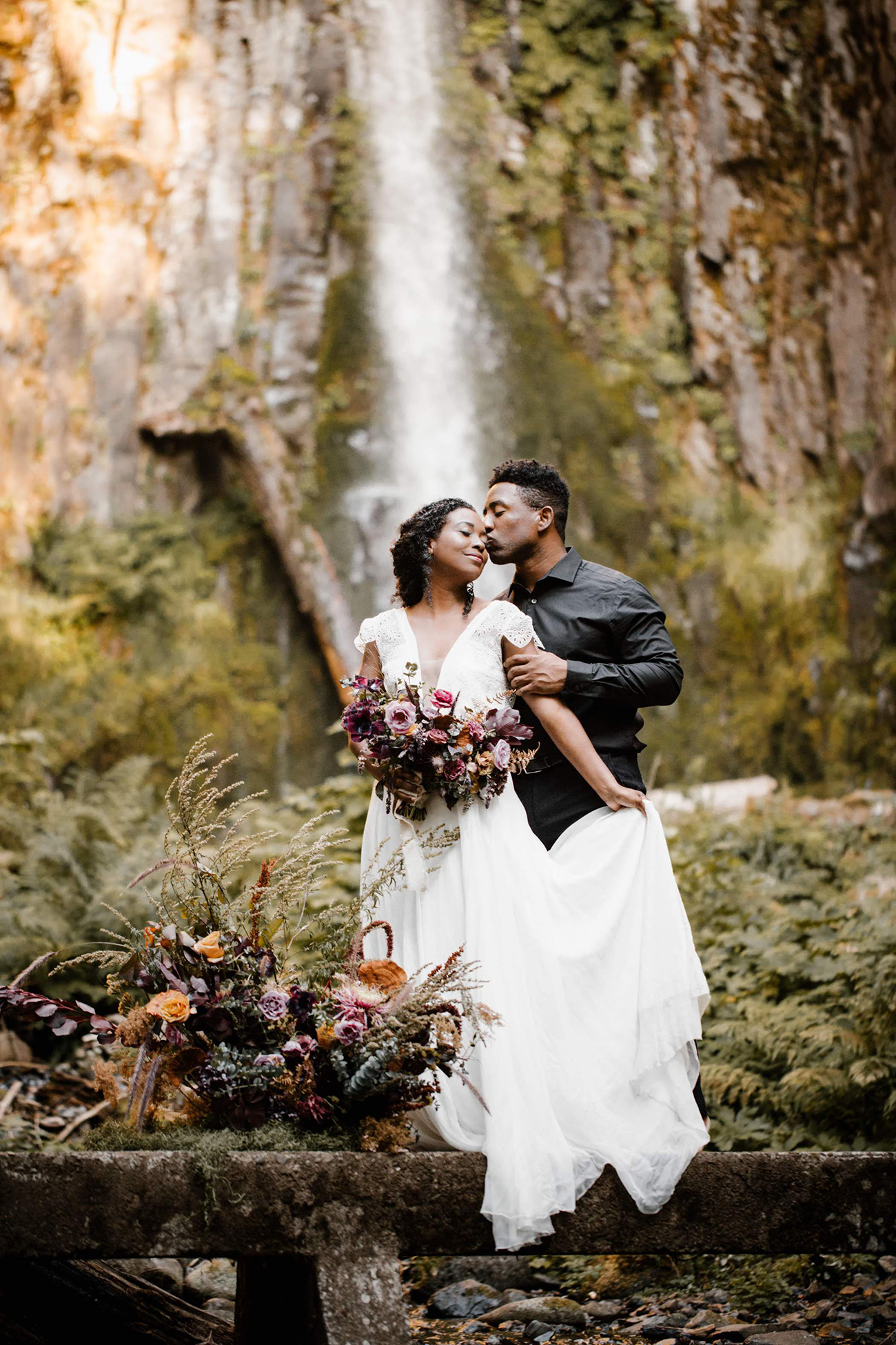 Elopement under a waterfall