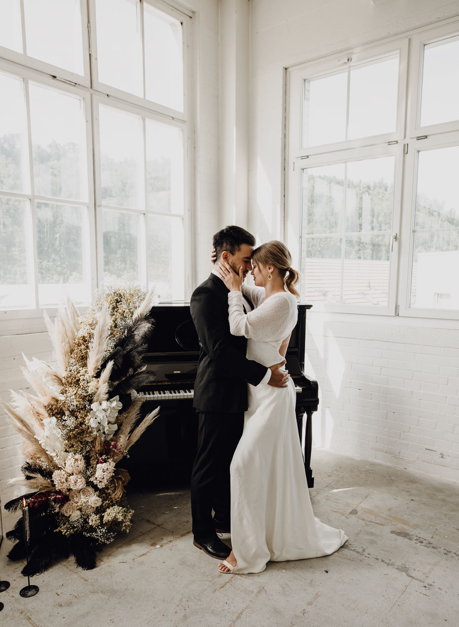 black piano wedding decor