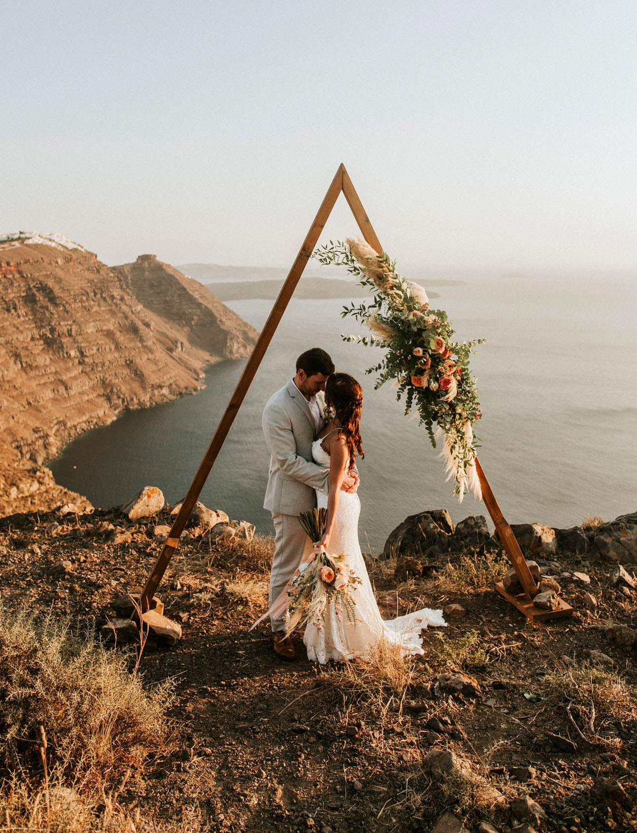 Cliffside Santorini Elopement with Fairy Lights Like You've Never Seen