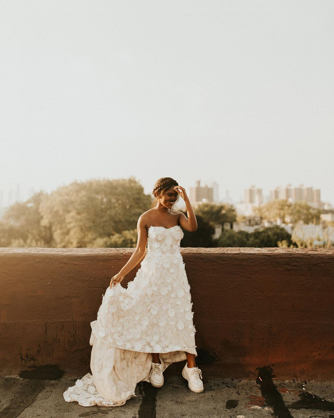 bride in sneakers with a floral white dress