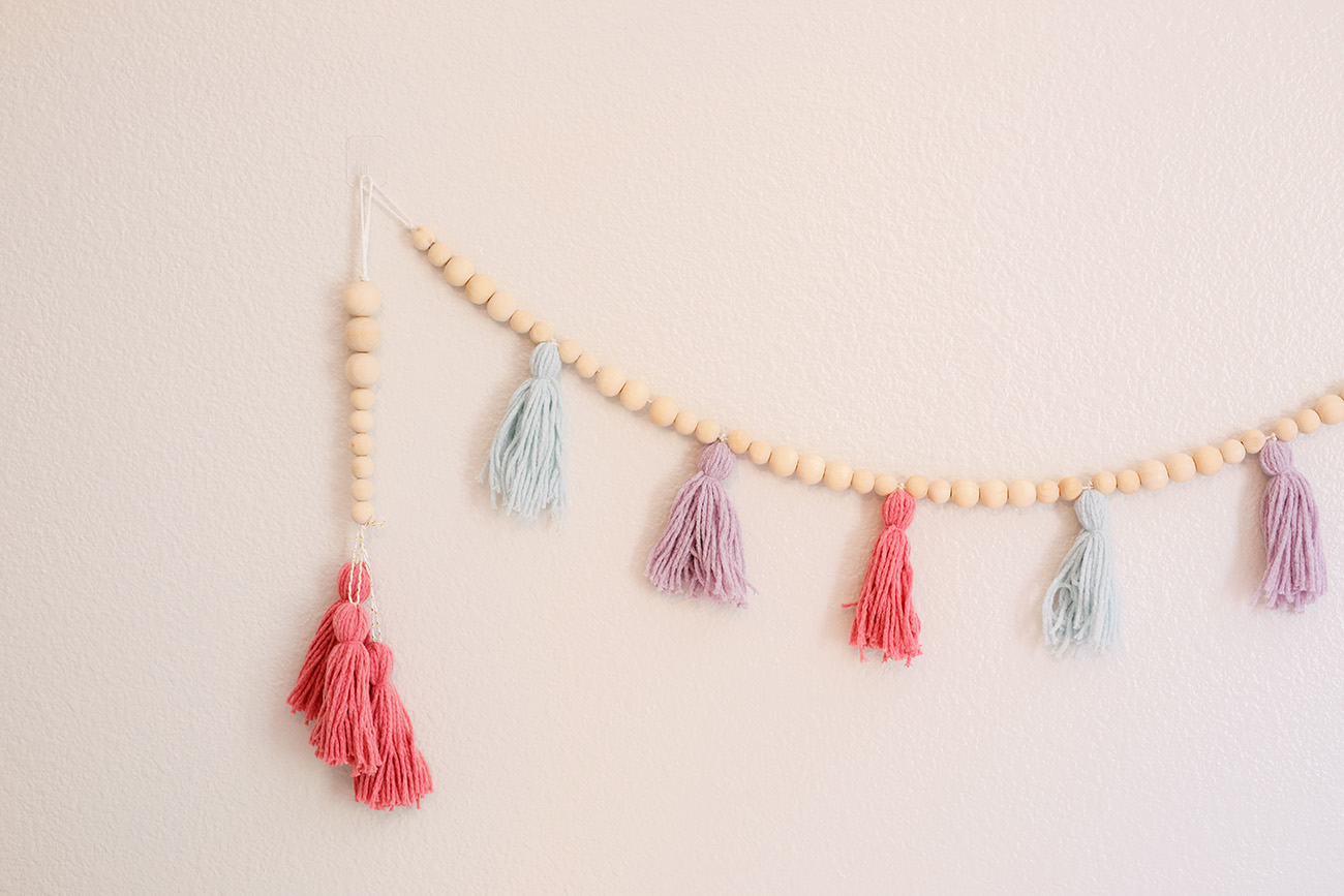 yarn tassel garland with wooden beads