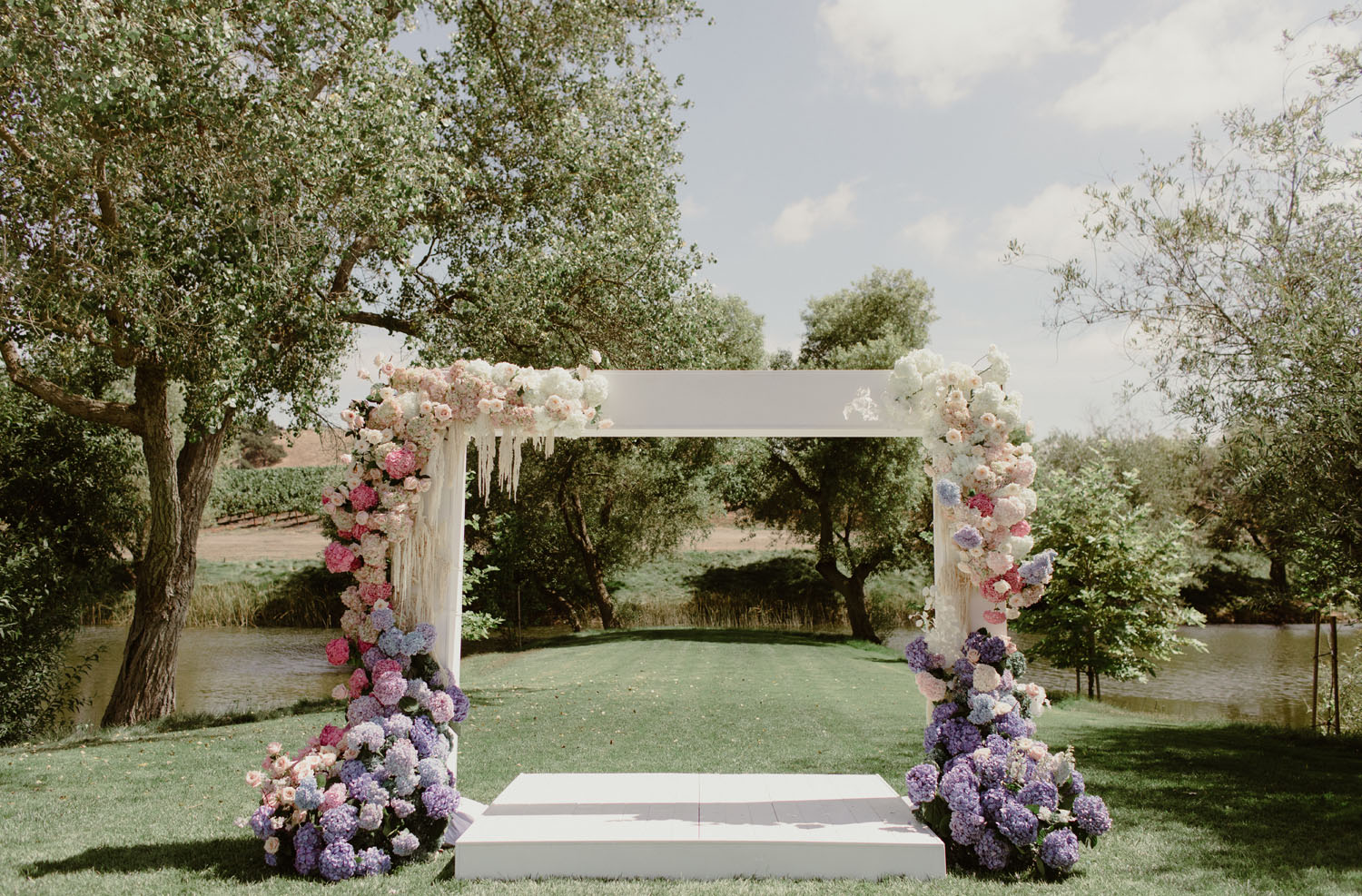 pink and purple floral arch