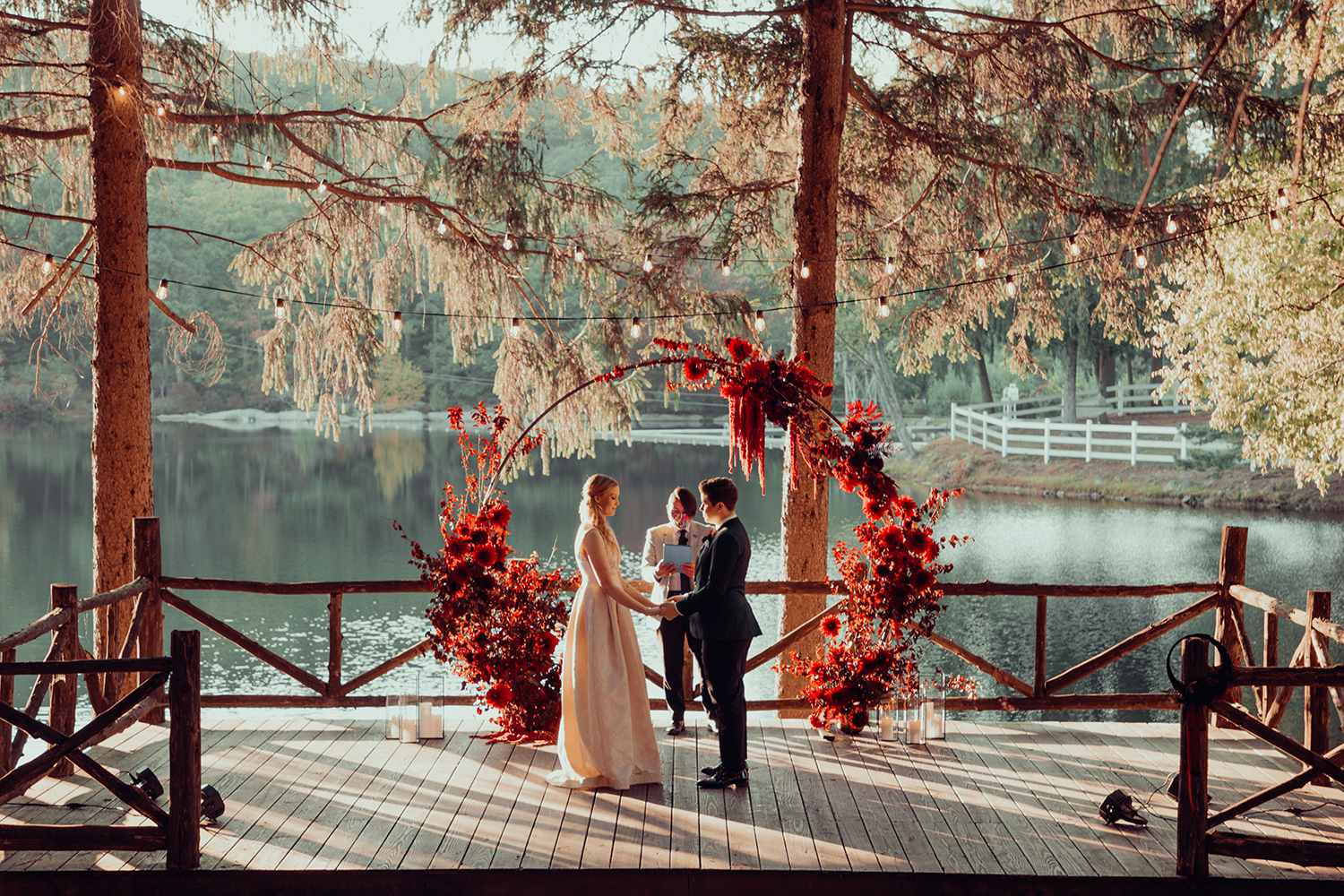 red floral wedding arch