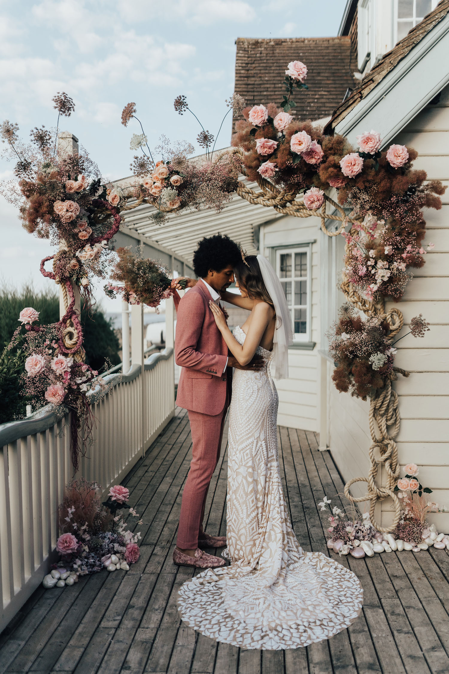 pink floral ceremony arch