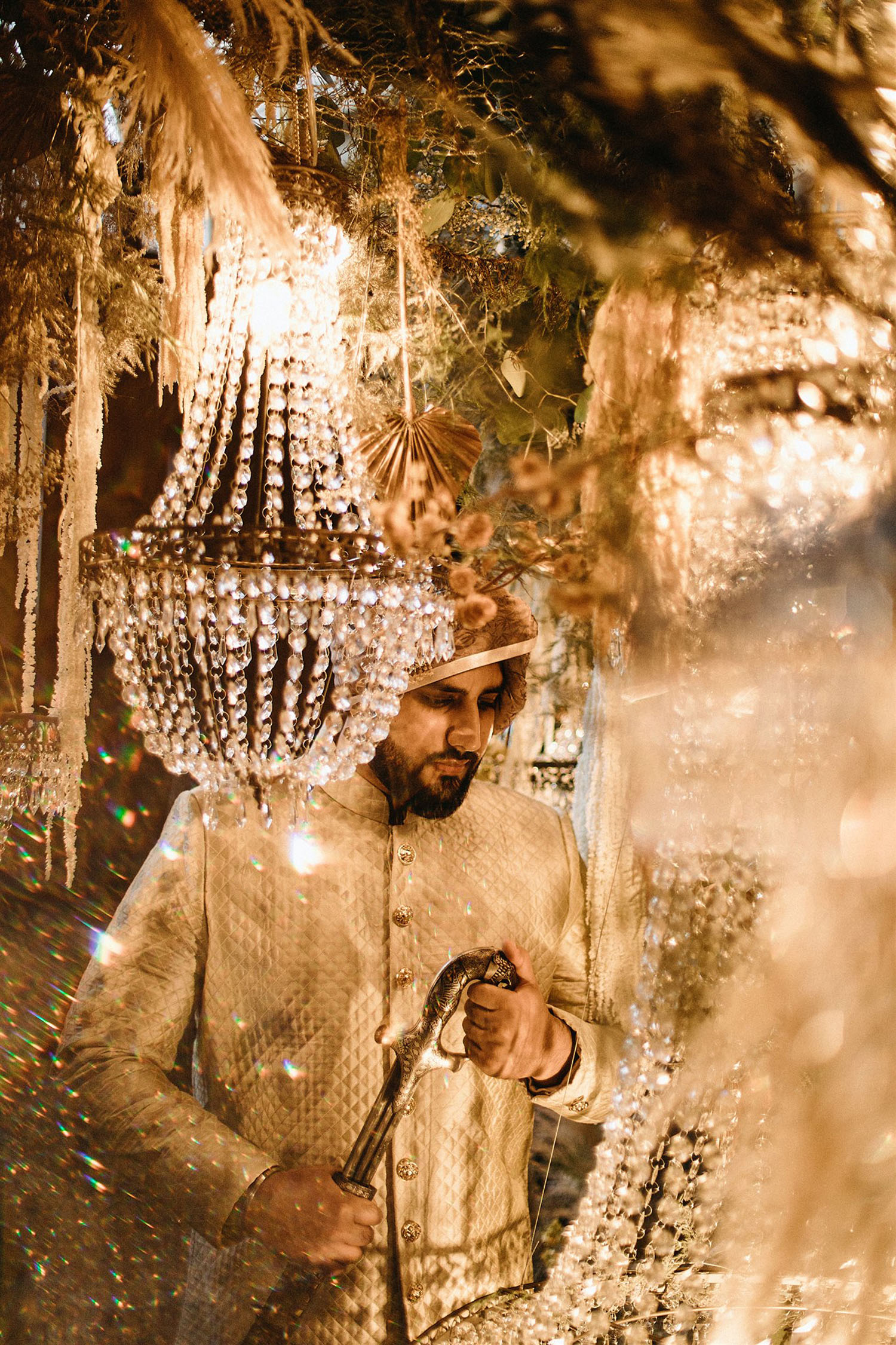 luxe South Asian wedding with chandelier decor