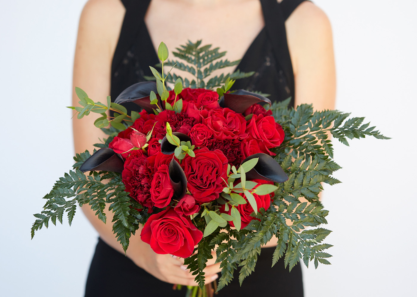 red bouquet with roses