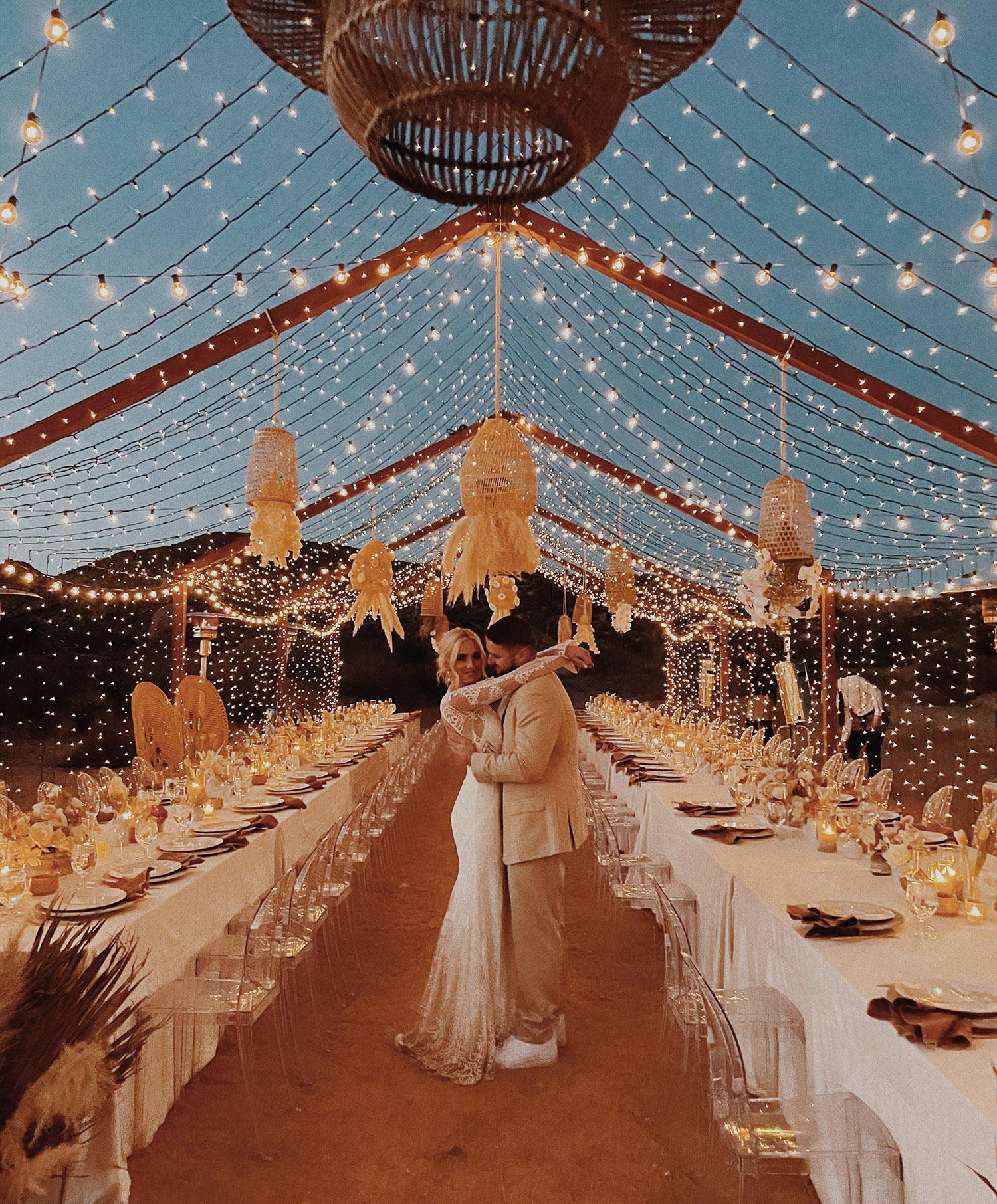 moho joshua tree wedding with couple under fairy lights