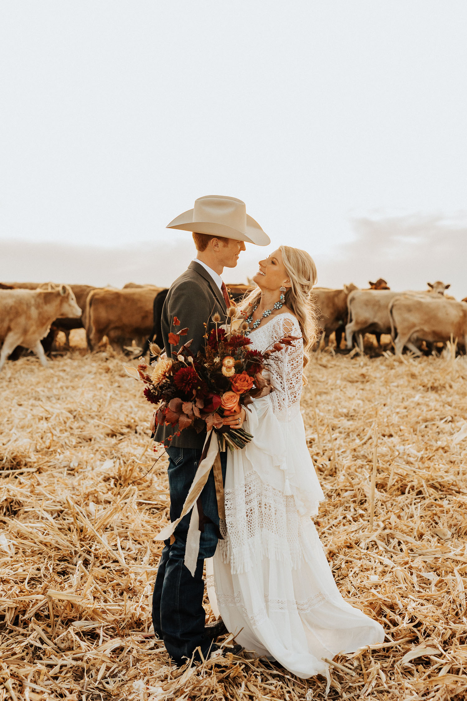 boho bride and groom on a cattle ranch