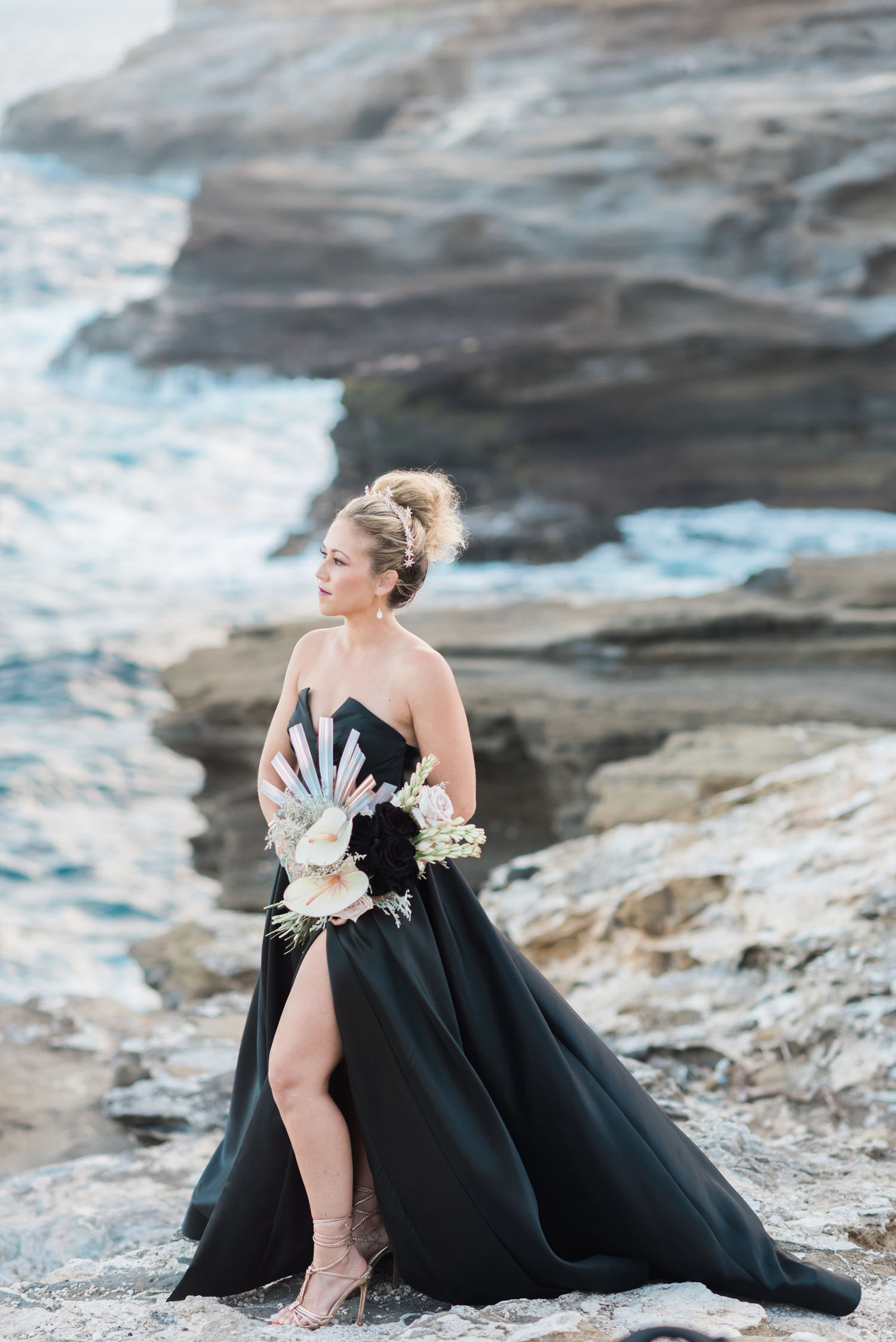 bride in black dress on cliffs