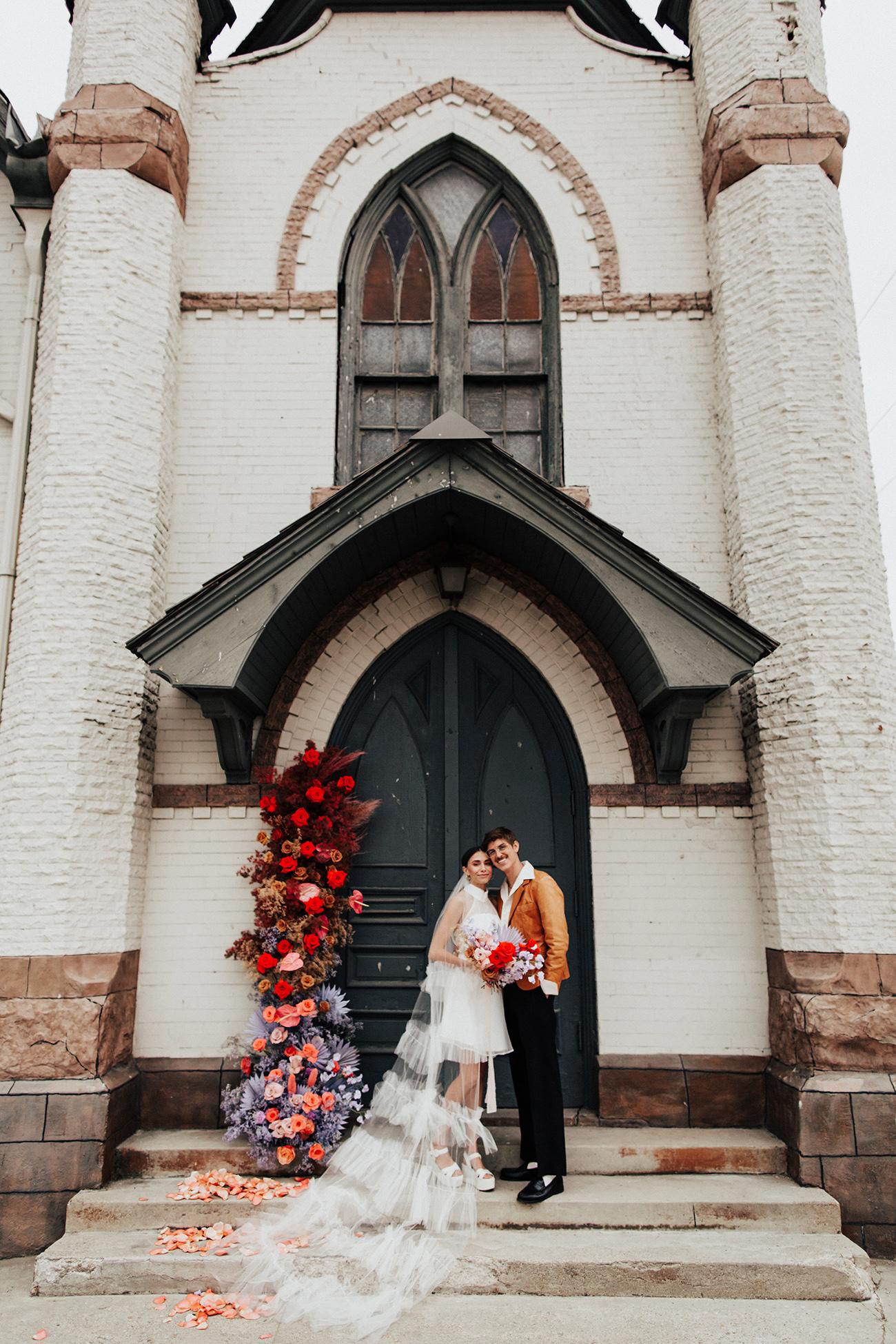 long ruffle veil and mini wedding dress