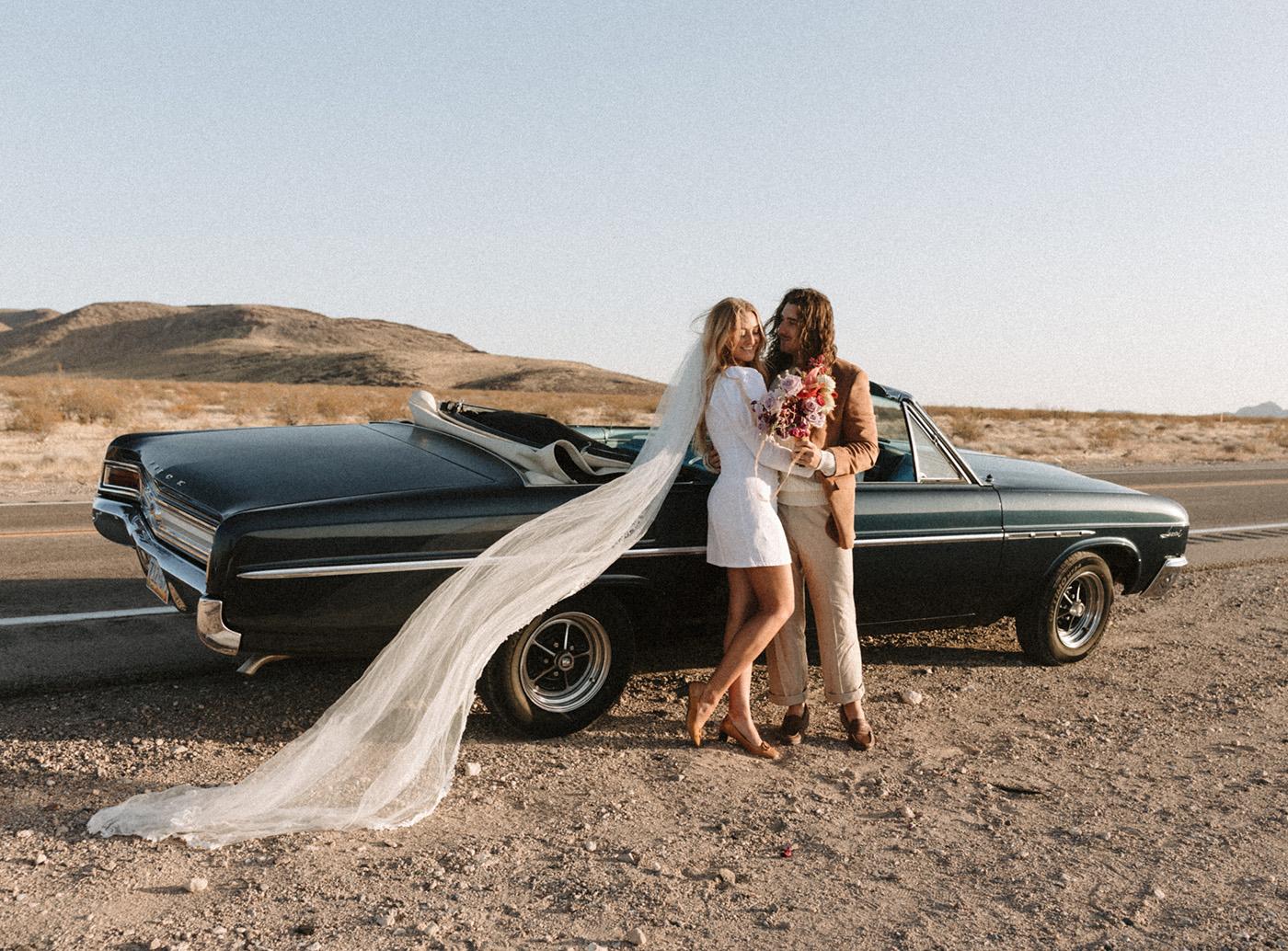 short wedding dress with long veil for vegas elopement