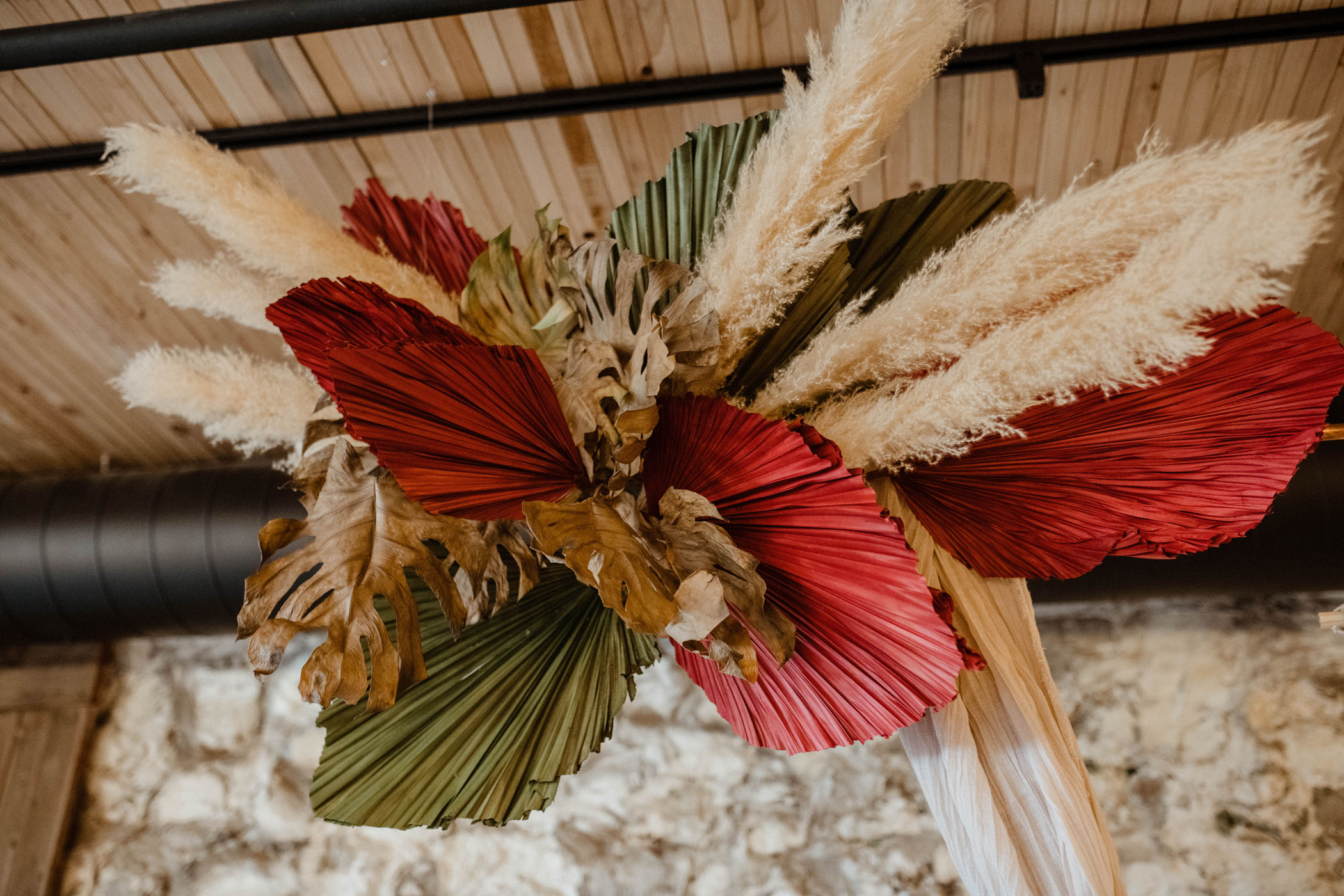 painted palm pampas grass installation