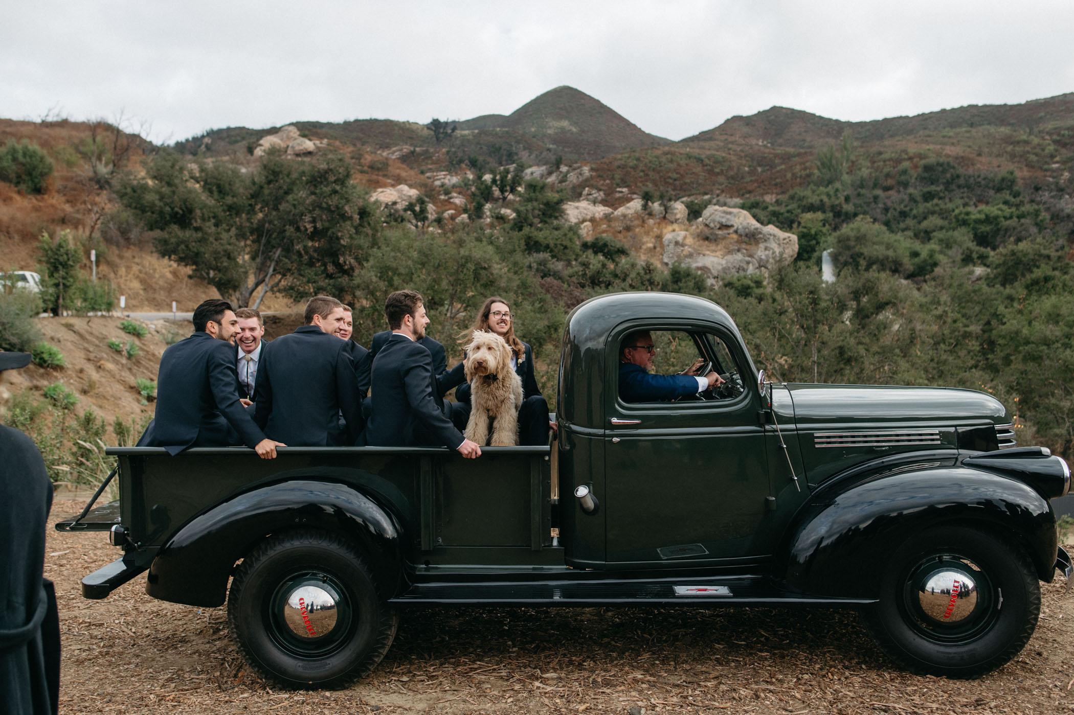 groomsmen arriving in truck