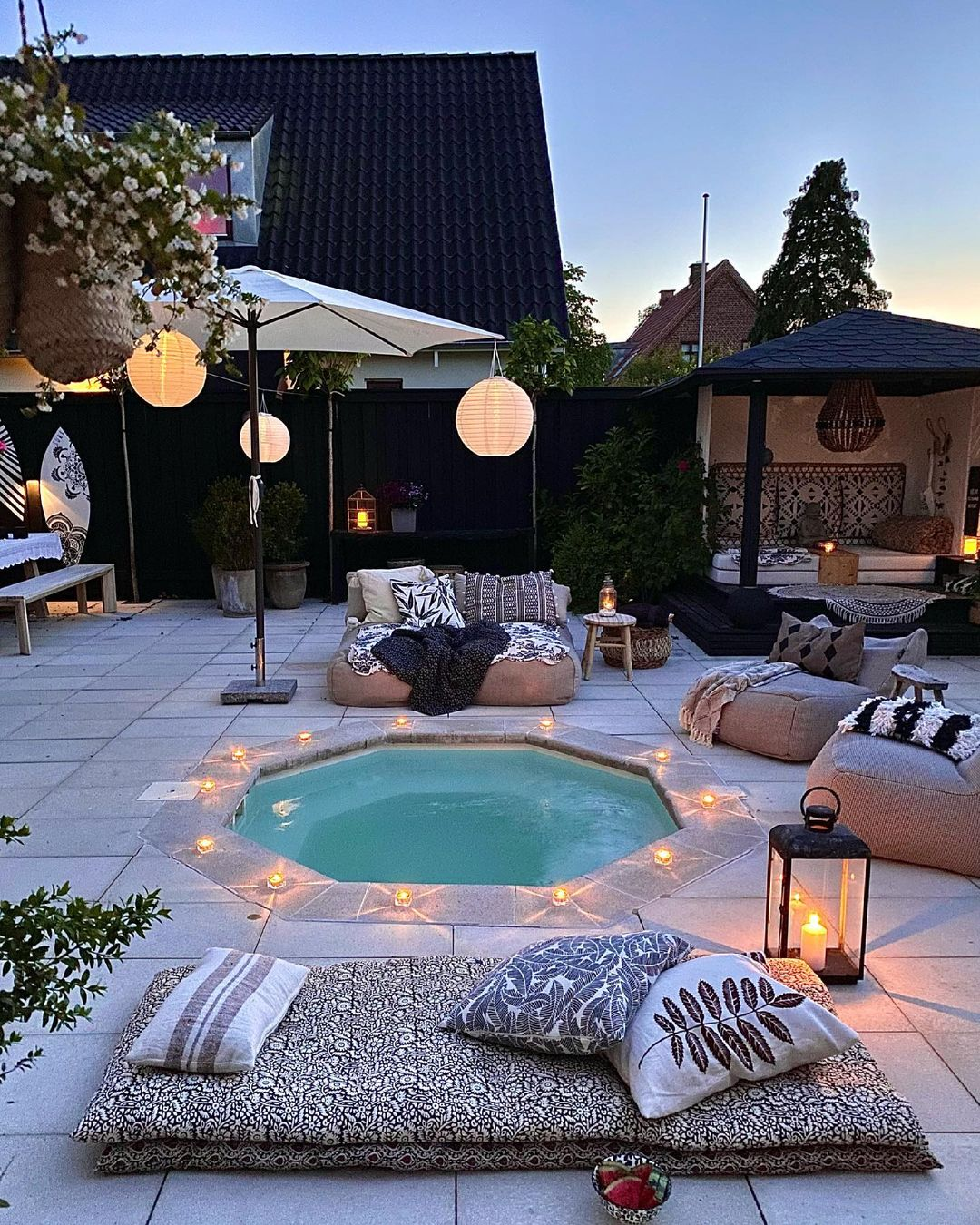 summer backyard set up with pool and pillows