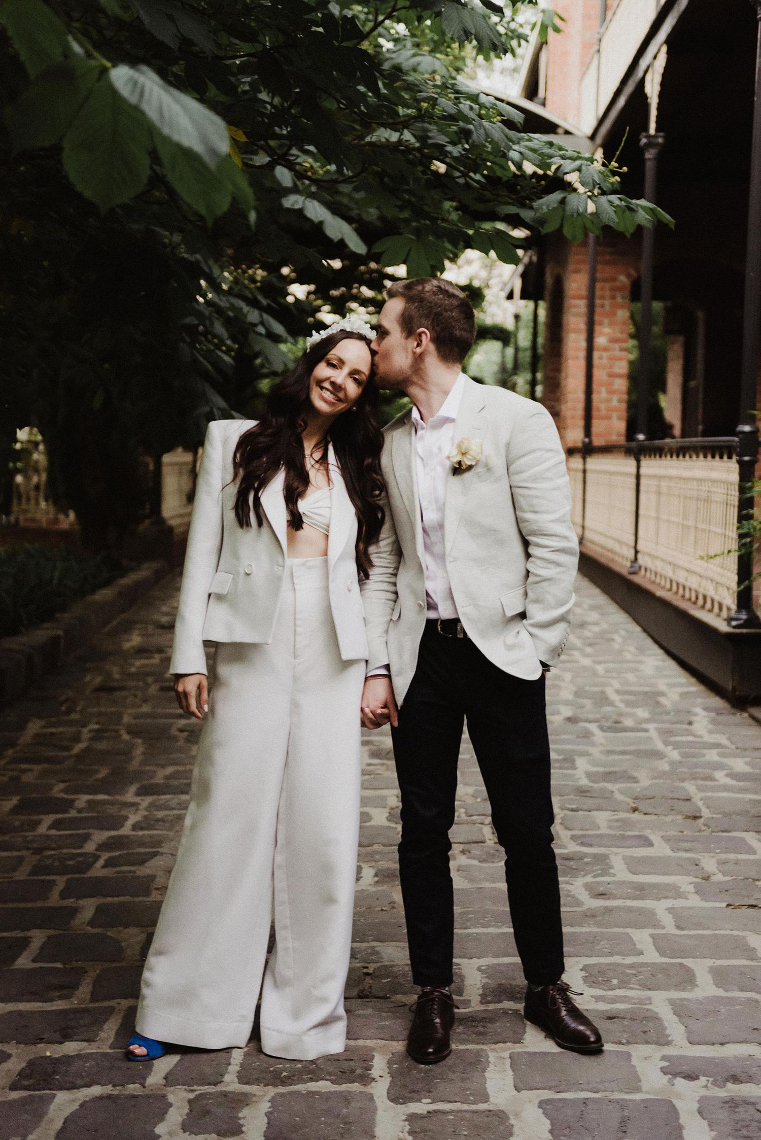 bride in white suit