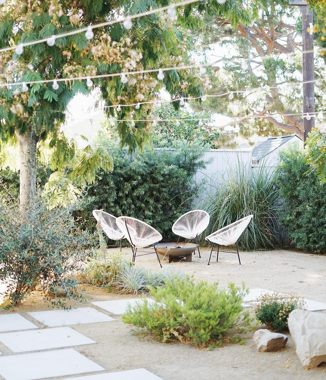 boho backyard garden white chairs fire pit