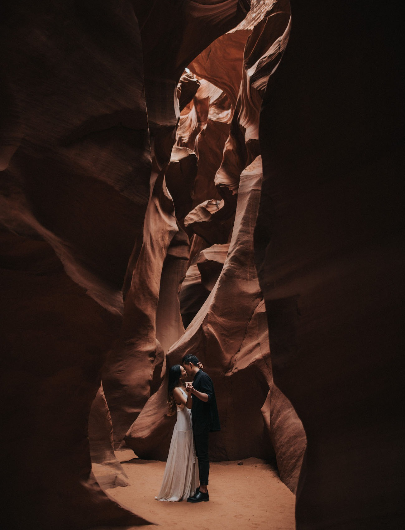 couple exploring a slot canyon in Page Arizona