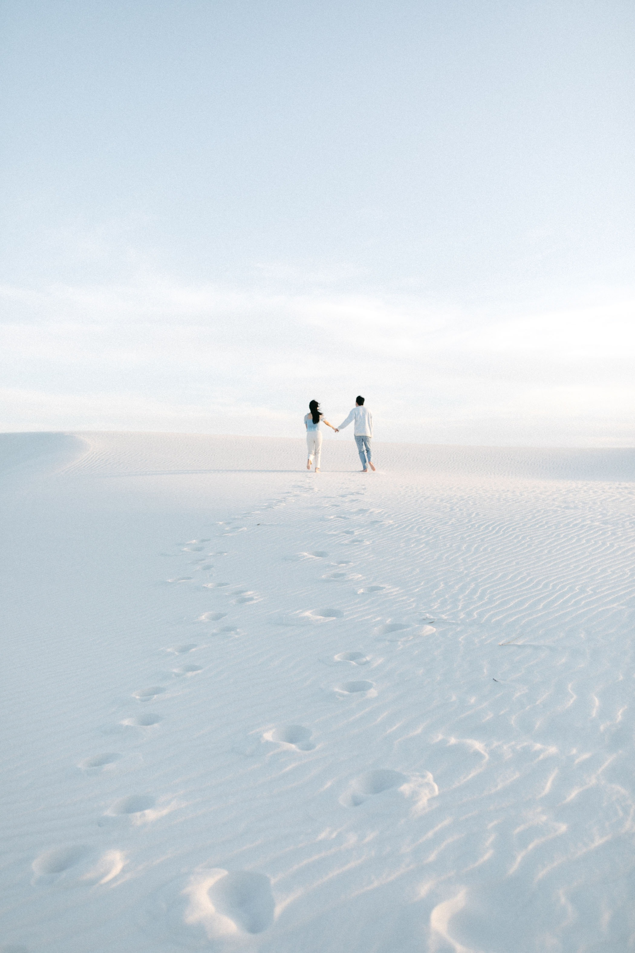 couple adventuring in White Sands in New Mexico
