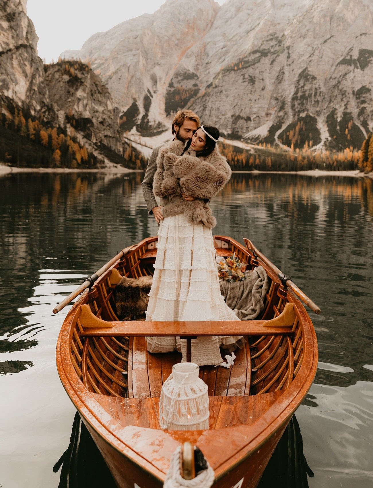couple standing on a canoe in the Italian Dolomites