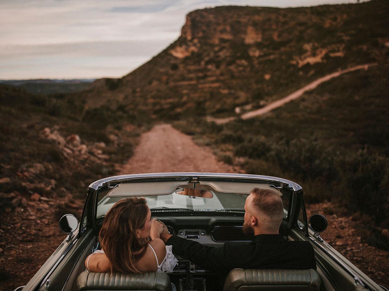 couple driving through Sierra Calderona Natural Park in Spain for their destination wedding
