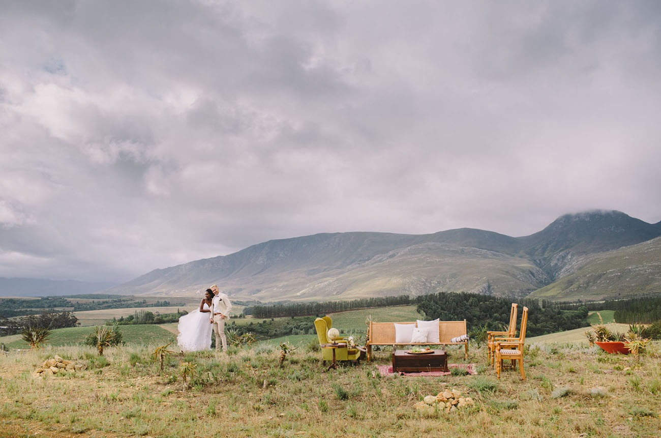 couple standing in the outdoors cocktail reception space for their South Africa destination wedding