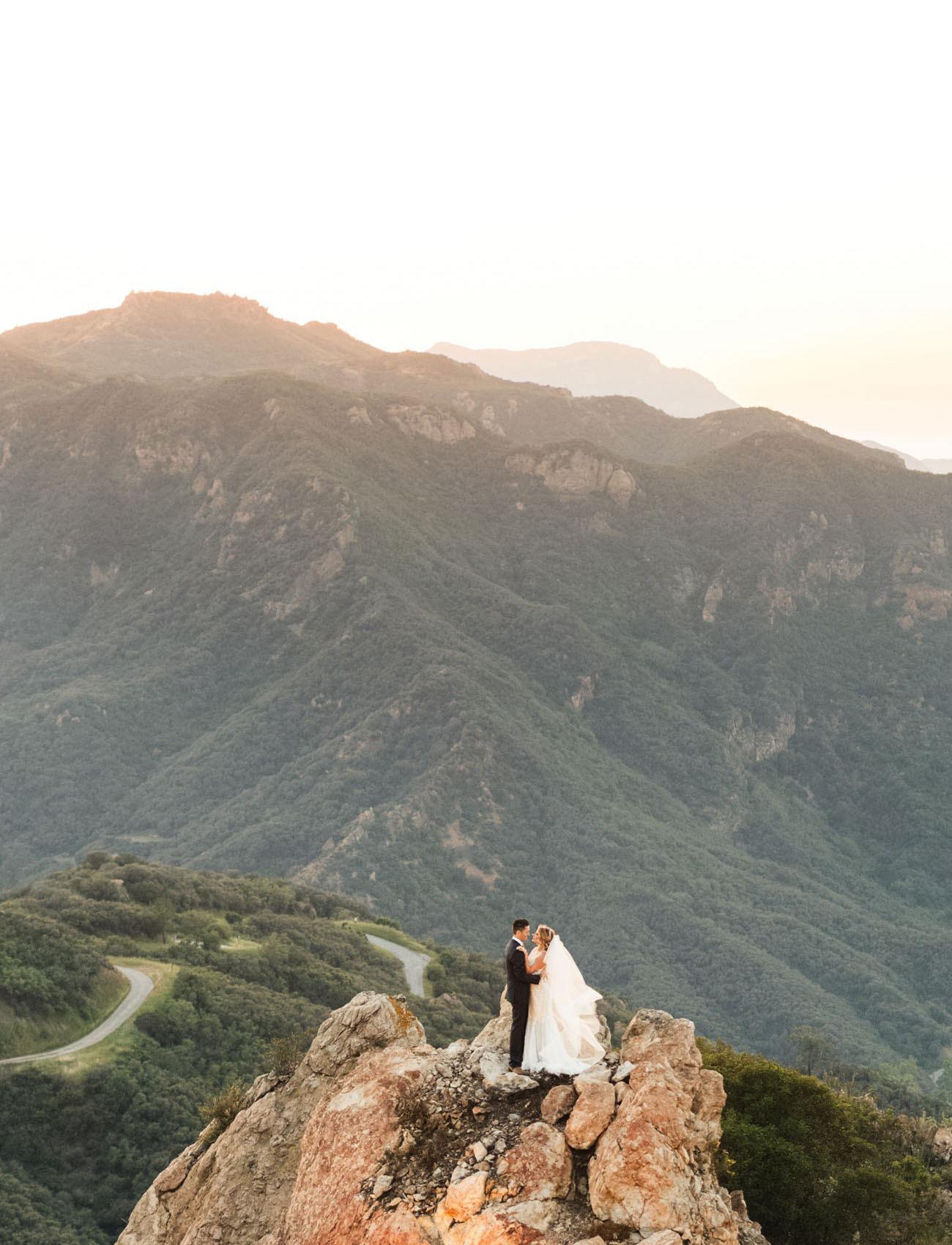 couple having their destination wedding at a cliffside venue in Malibu California