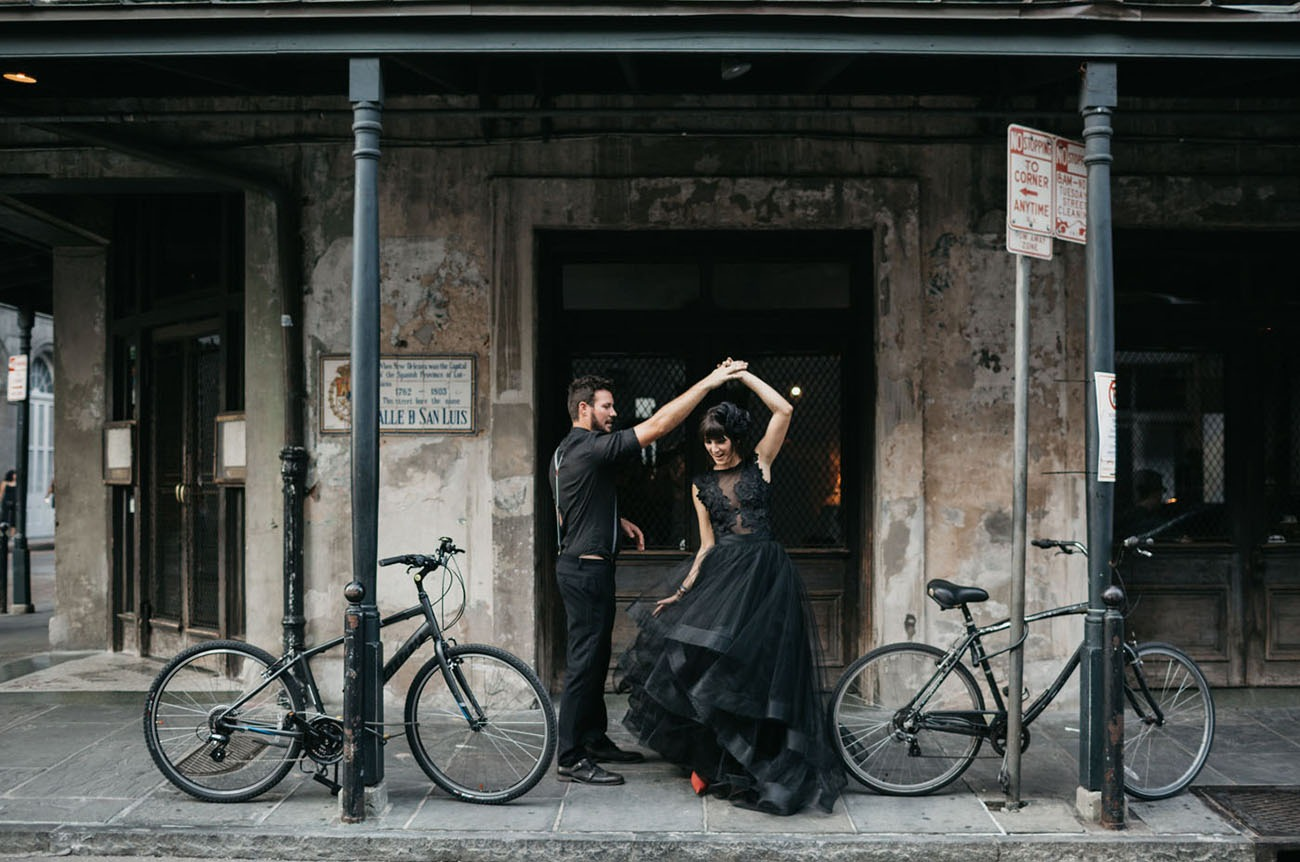 New Orleans Louisiana couple dancing on the sidewalk in an epic honeymoon destination in the US